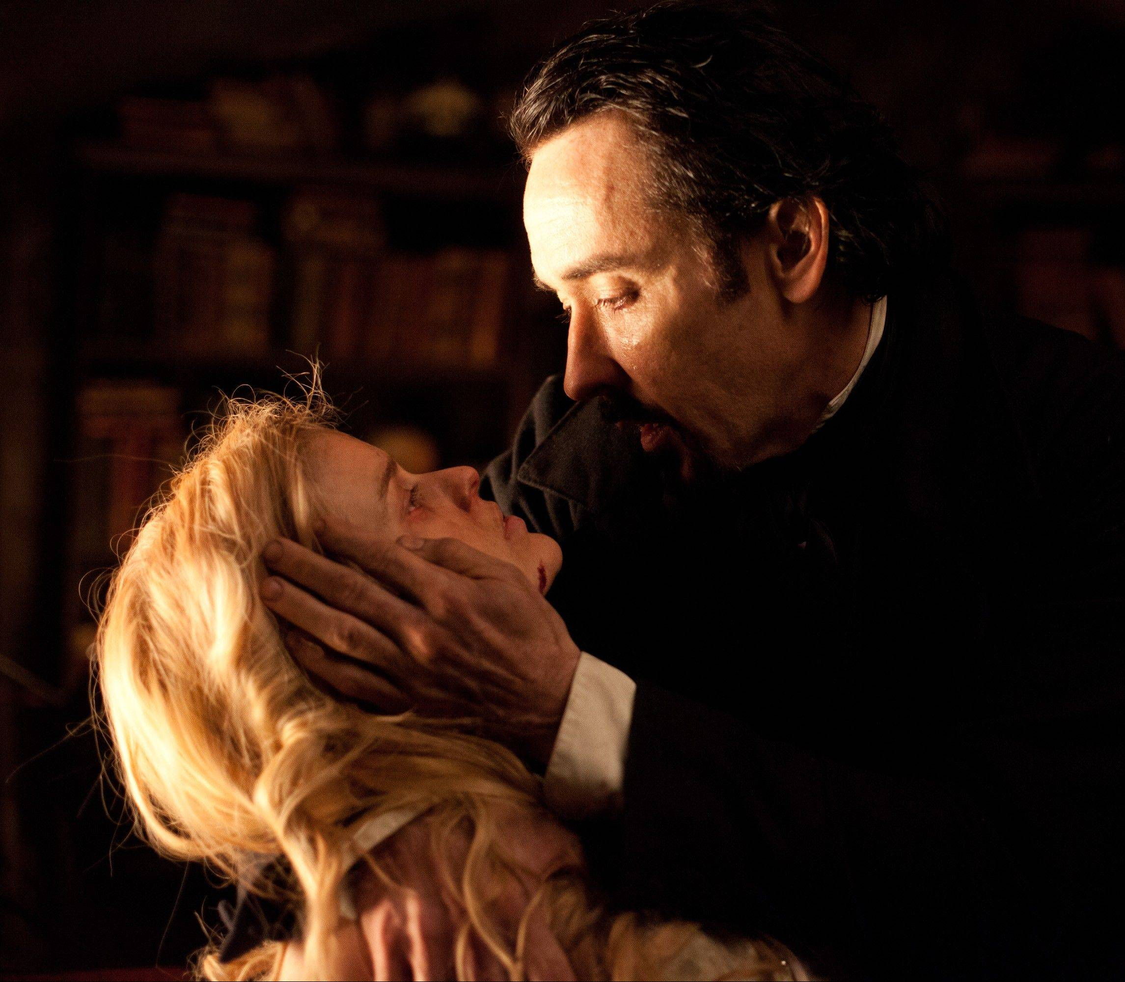 "Edgar Allan Poe (John Cusack) must stop a diabolical serial killer before he threatens the life of his fiance (Alice Eve) in the period thriller ""The Raven."""