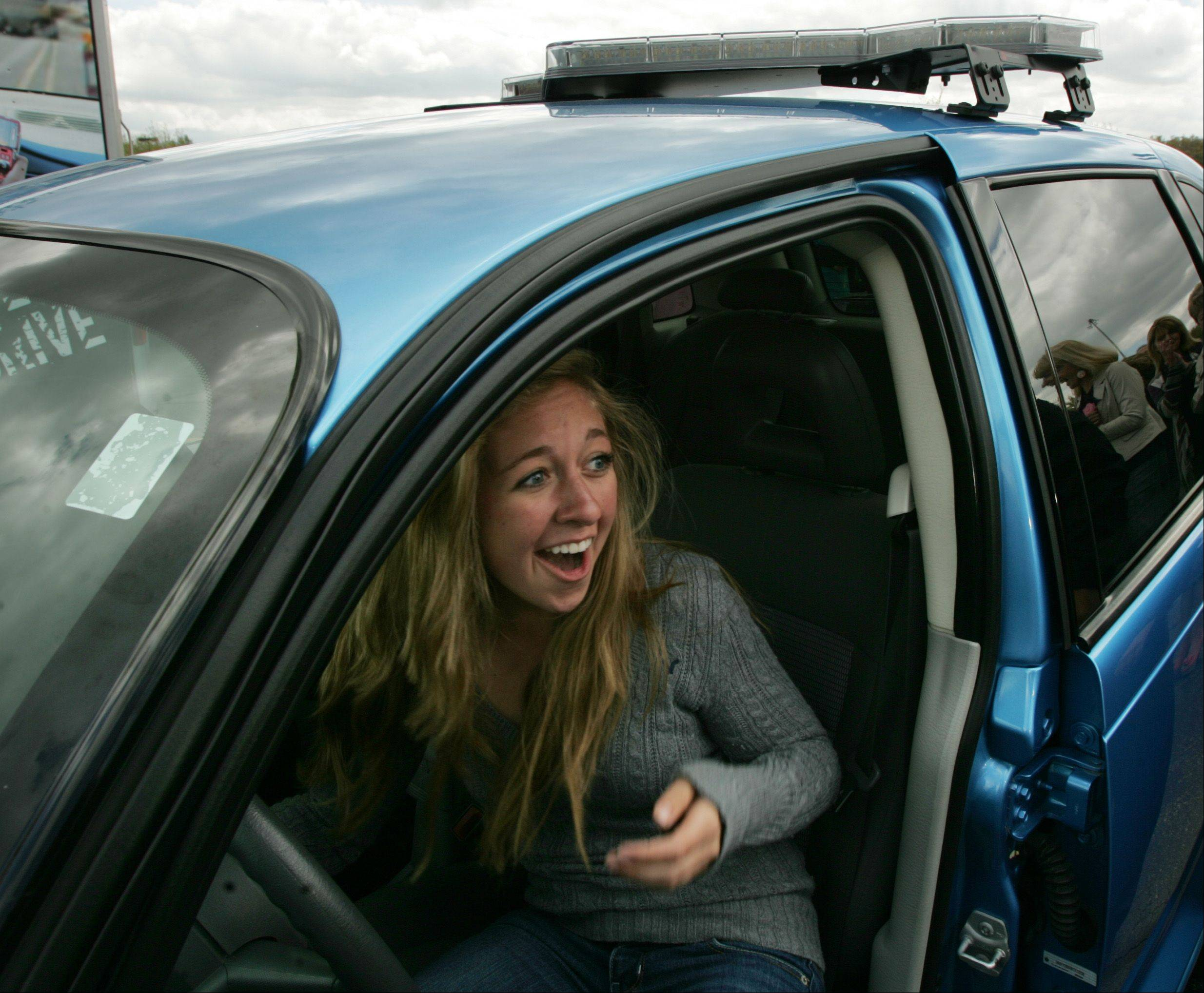 Crystal Lake Central junior Mikayla Tuszynski can hardly believe she won the blue 2008 Chrysler PT Cruiser Thursday in Crystal Lake at the 2012 banquet for Operation Click. Students at a growing number of high schools are signing a pledge to drive safely, including wearing seat belts and not getting any tickets or other violations. Finalists with the highest percentage from the participating high schools get a chance to pull a key from a bowl to see if the car starts. Thanks to donations from Crystal Lake Chrysler Jeep Dodge Ram, and Black Diamond Plumbing, two cars were given away Thursday.