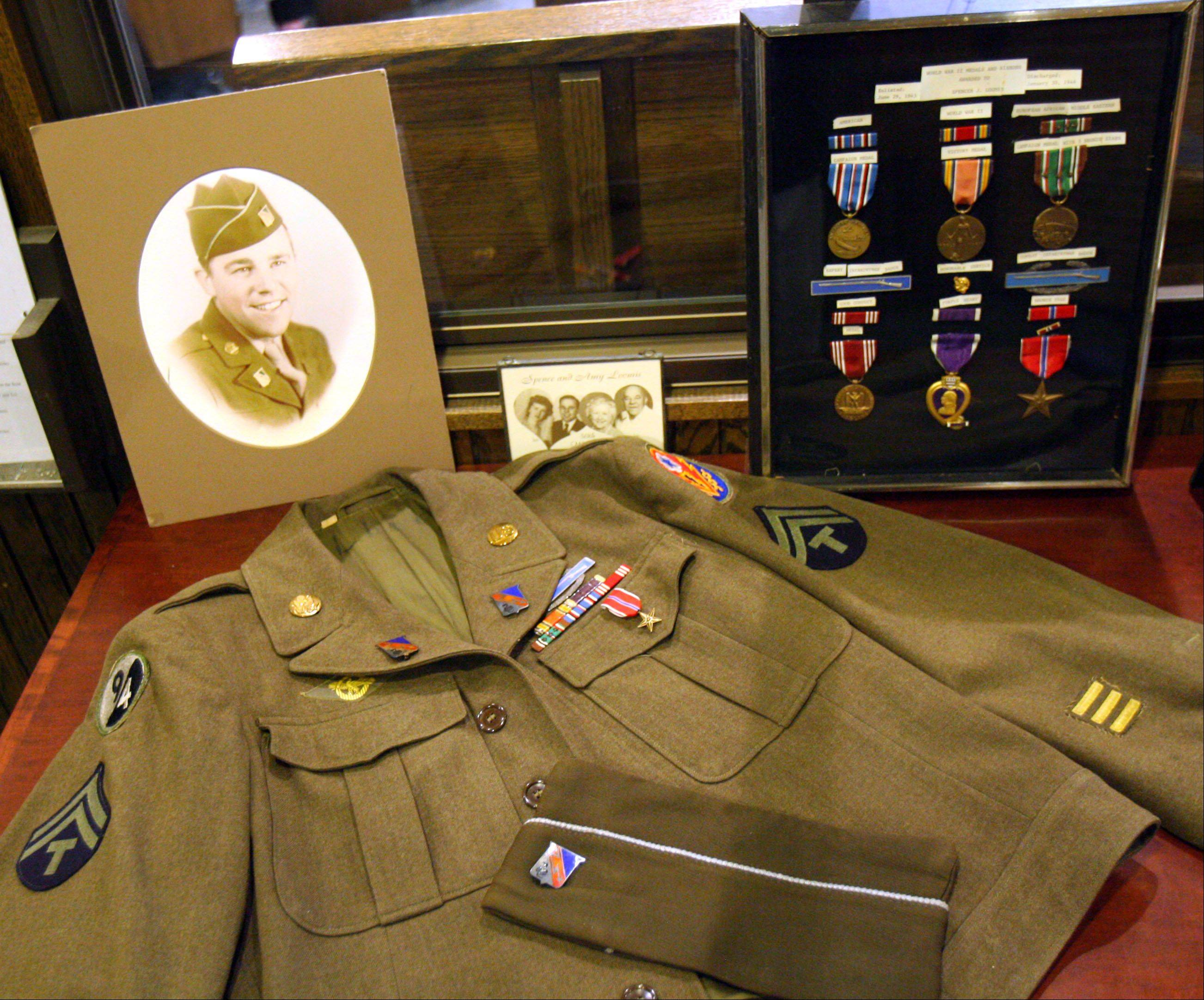 Spencer Loomis' Army uniform and medals, which include the Purple Heart and the Bronze Star, were on display as family and friends gathered at St. Peter United Church of Christ in Lake Zurich for his funeral Thursday. The Lake Zurich-area historian and teacher died last weekend.