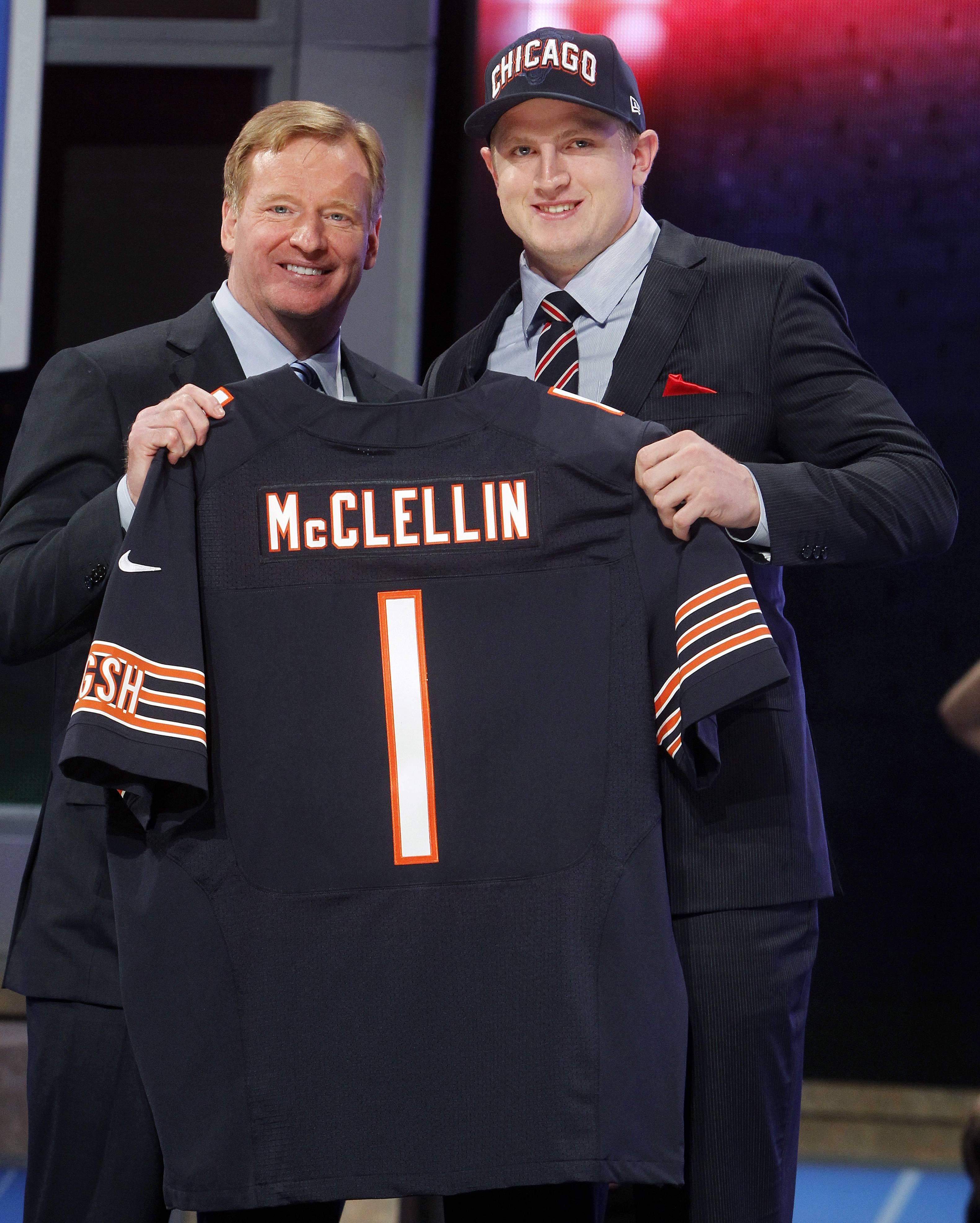 Boise State defensive end Shea McClellin, right, poses for photographs with NFL Commissioner Roger Goodell after being selected 19th overall by the Bears in the first round of the NFL football draft at Radio City Music Hall.