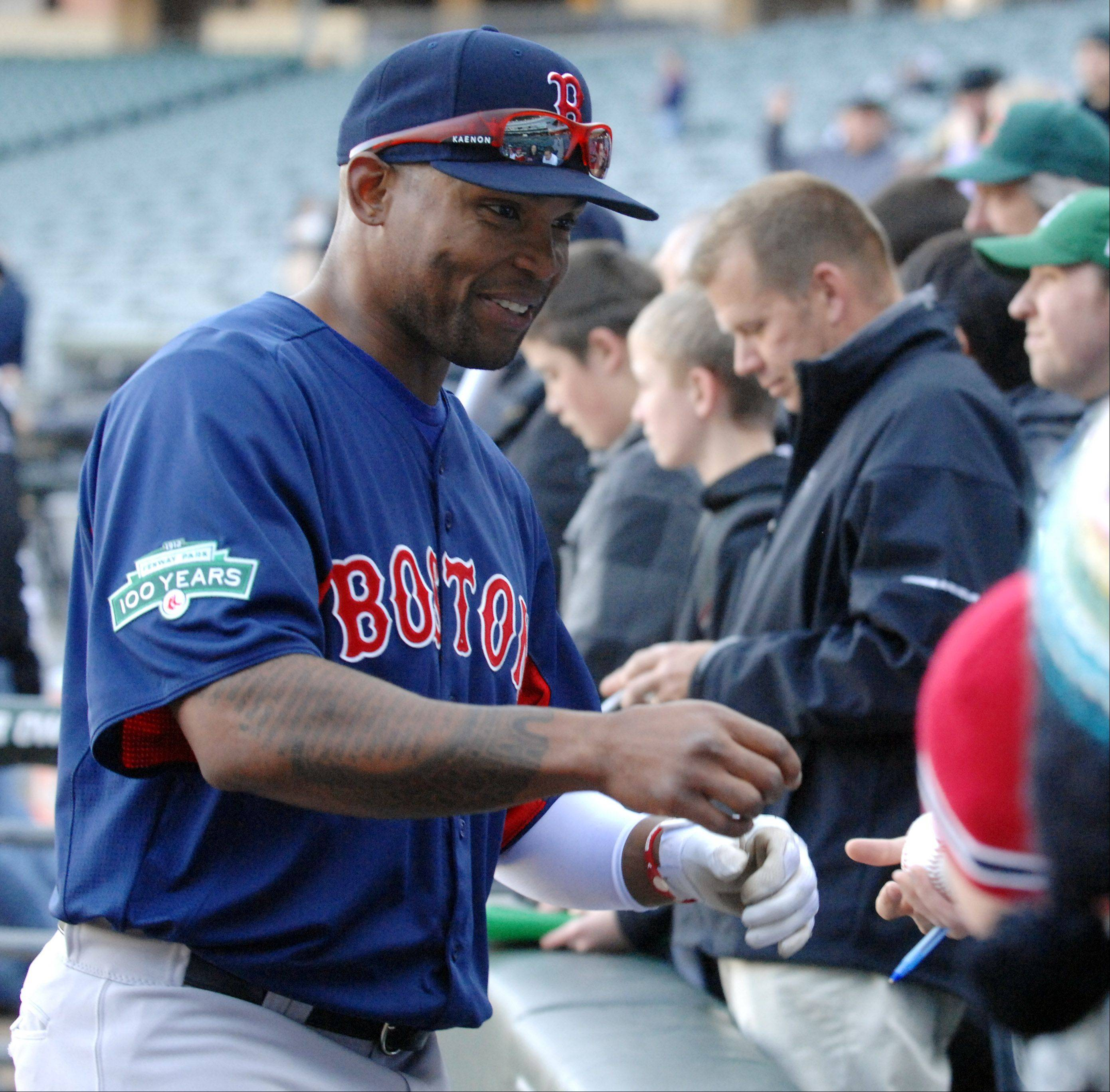 Former Cub and current Red Sox outfielder Marlon Byrd signs autographs before the game.
