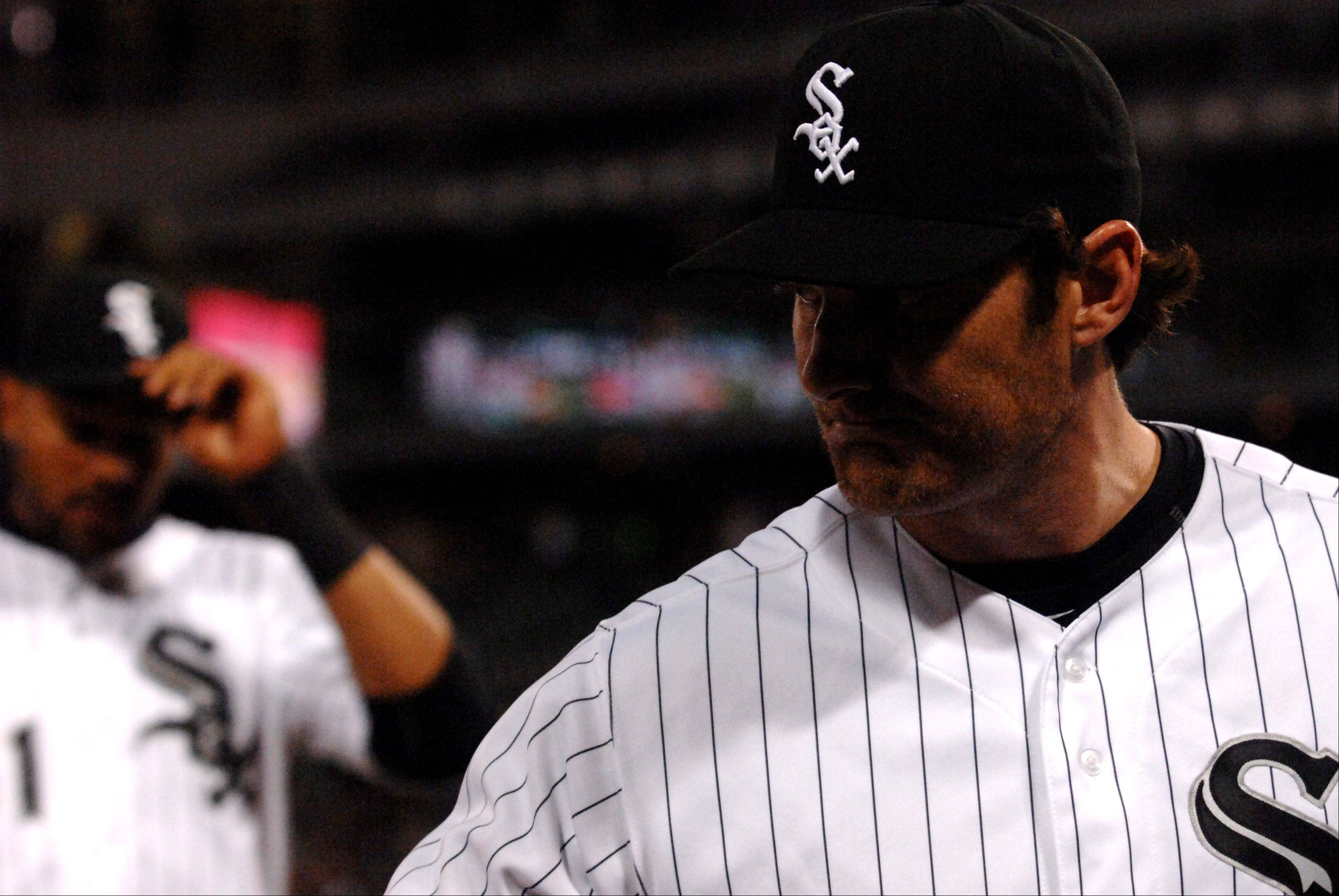 Chicago White Sox starting pitcher Philip Humber heads into the dugout after his final inning of work.