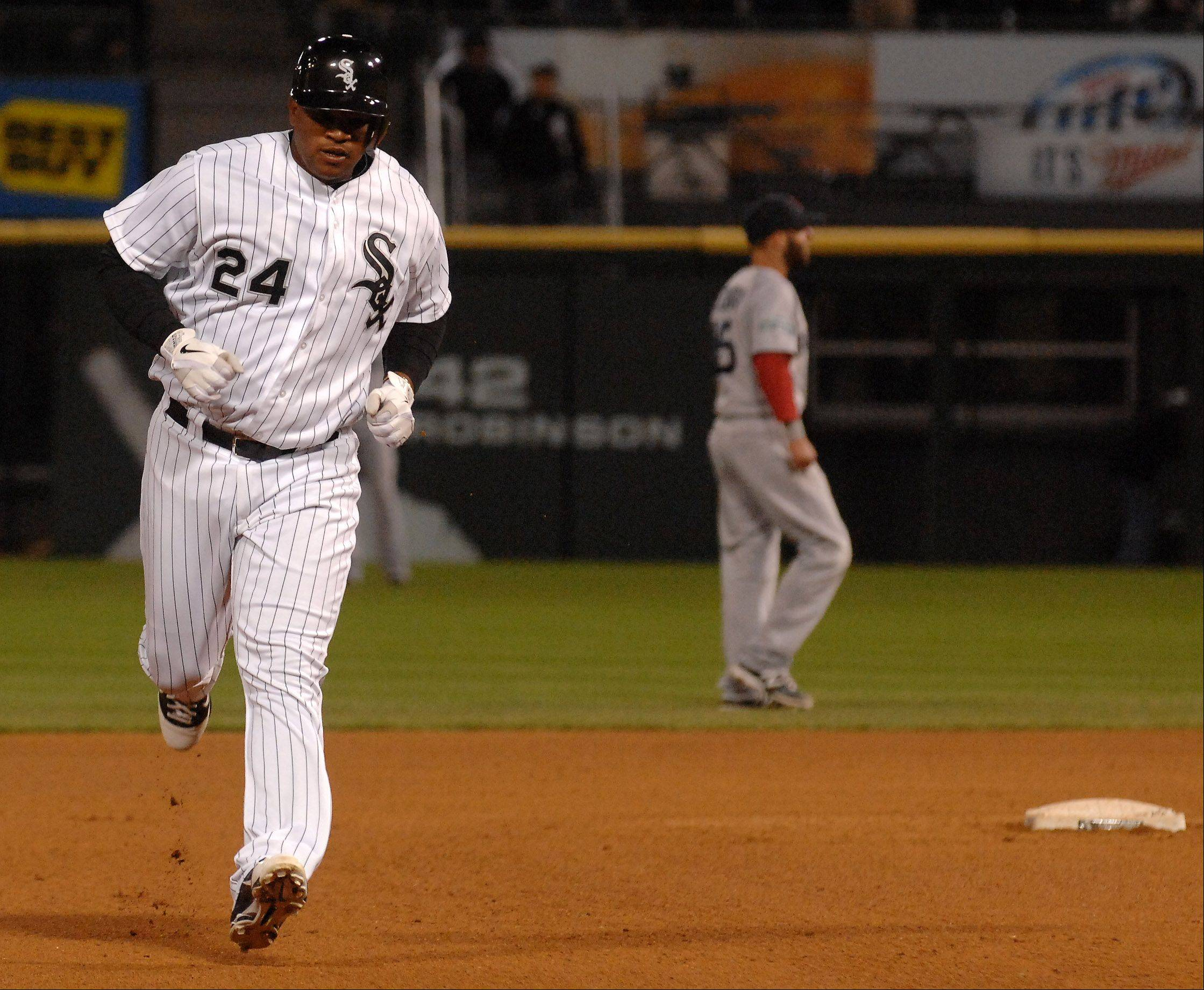 Chicago White Sox left fielder Dayan Viciedo circles the bases after a home run.