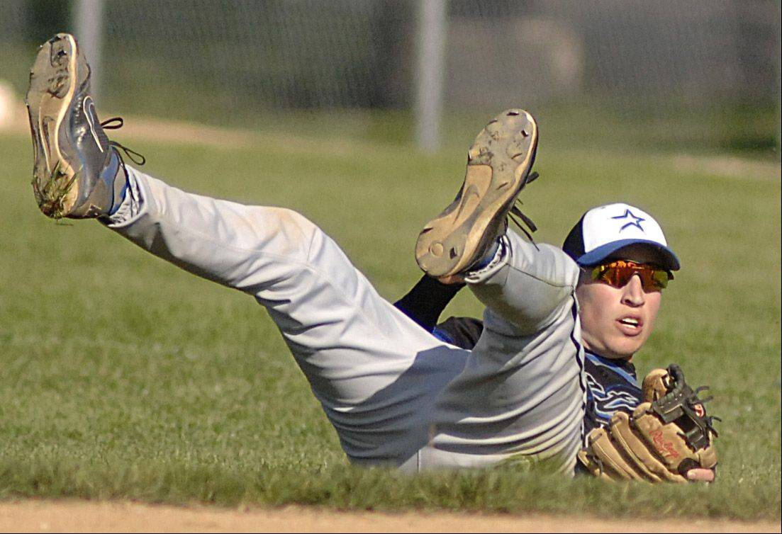 St. Charles North's Andrew Kronke falls while diving for the ball and misses it in the third inning on Thursday, April 26.