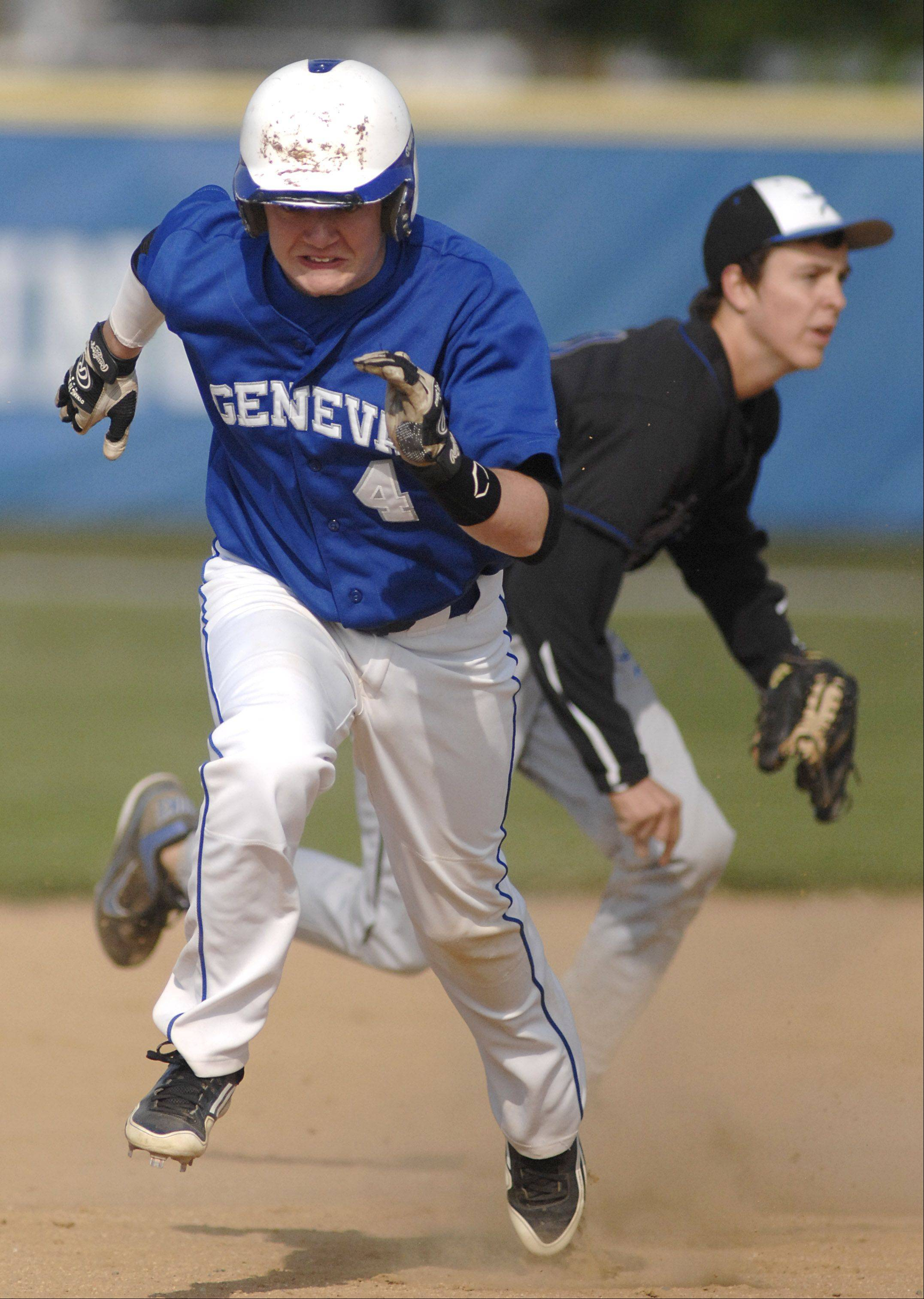 Geneva's Andy Francis takes off for third base in the first inning on Thursday, April 26.