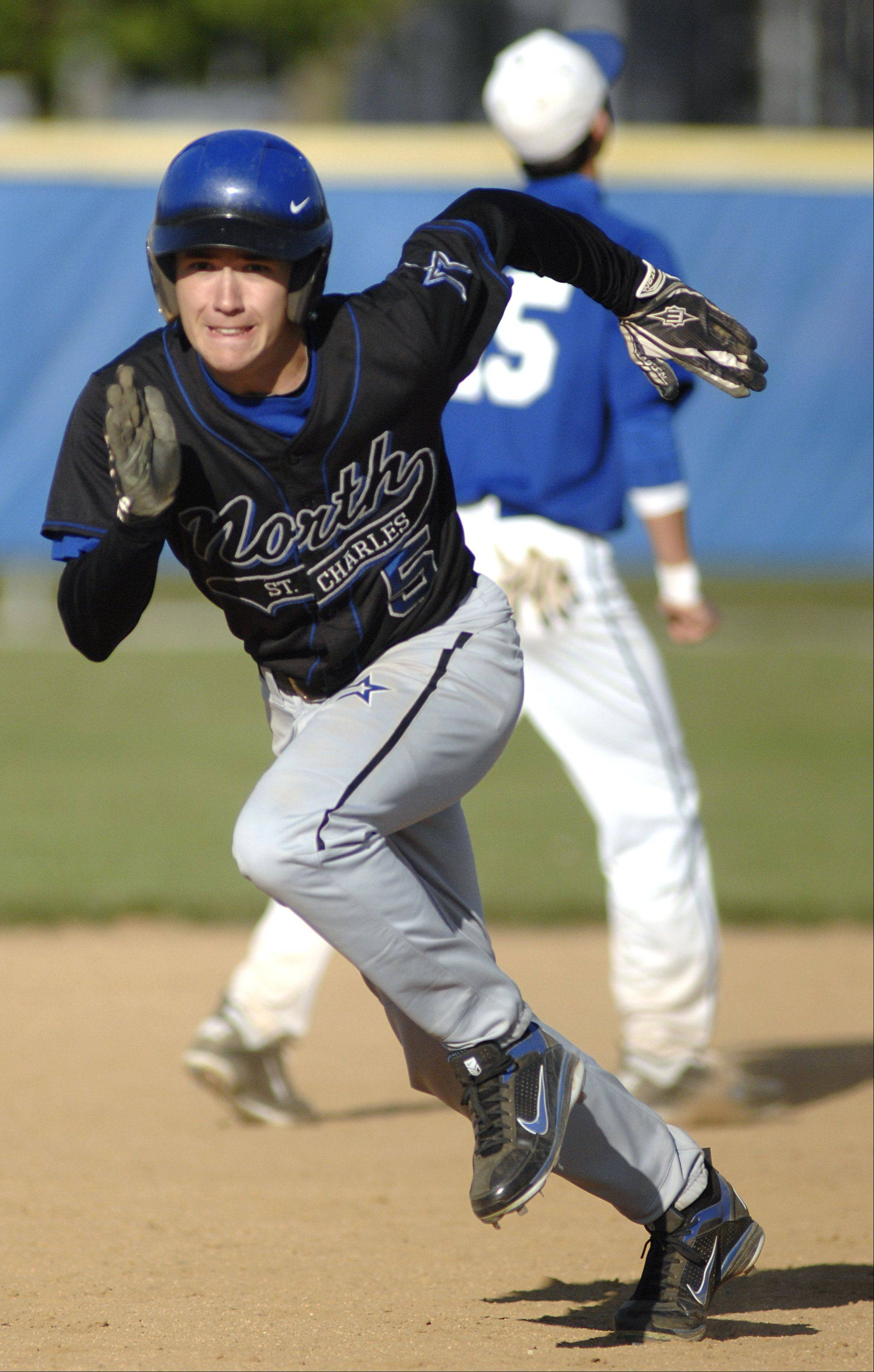 St. Charles North's Kurt Barbeau bolts for third base in the fifth inning on Thursday, April 26.