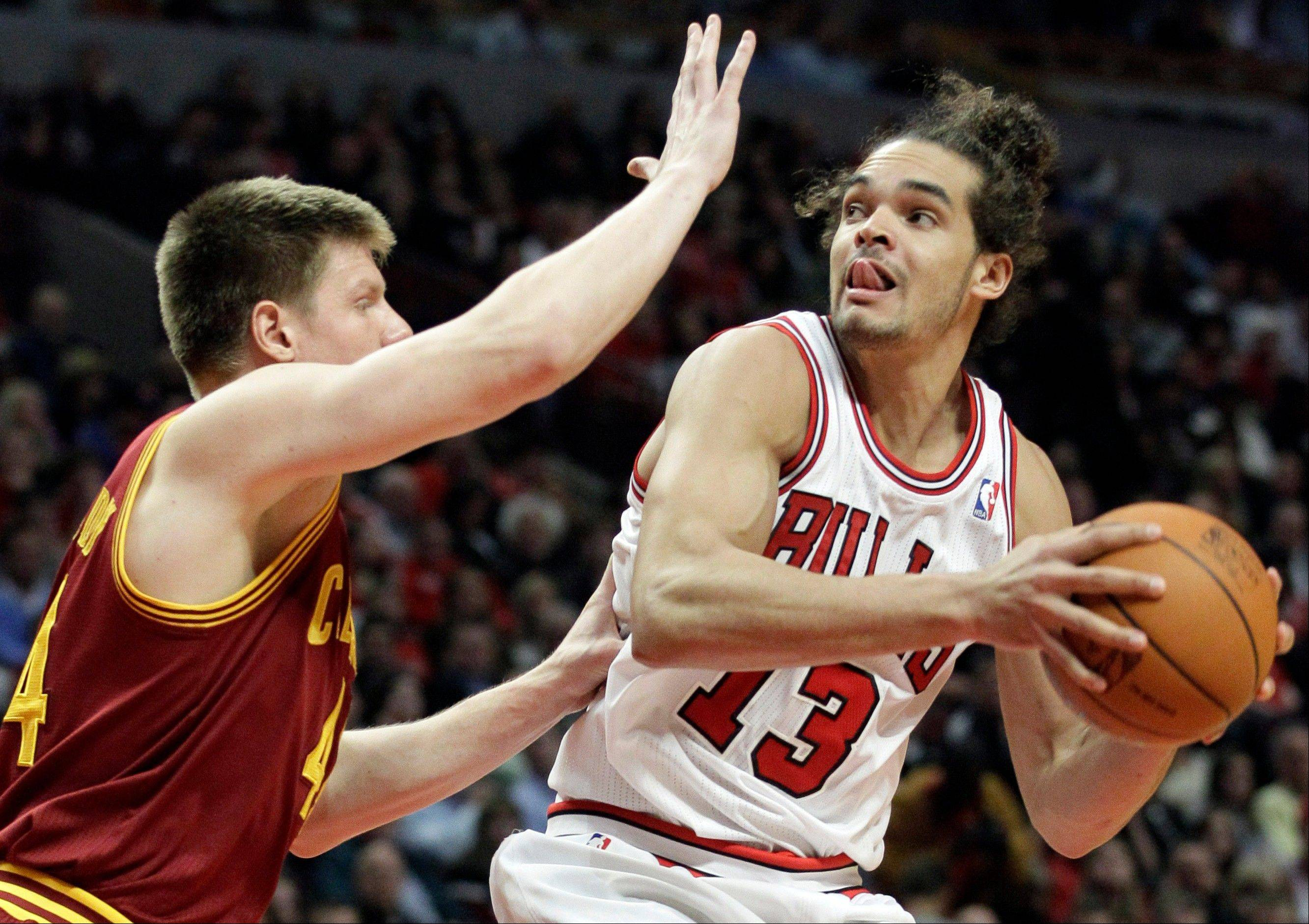 Chicago Bulls center Joakim Noah (13) looks to the basket as Cleveland Cavaliers forward Luke Harangody (44) guards during the second half of an NBA basketball game in Chicago, Thursday, April 26, 2012. The Bulls won 107-75.