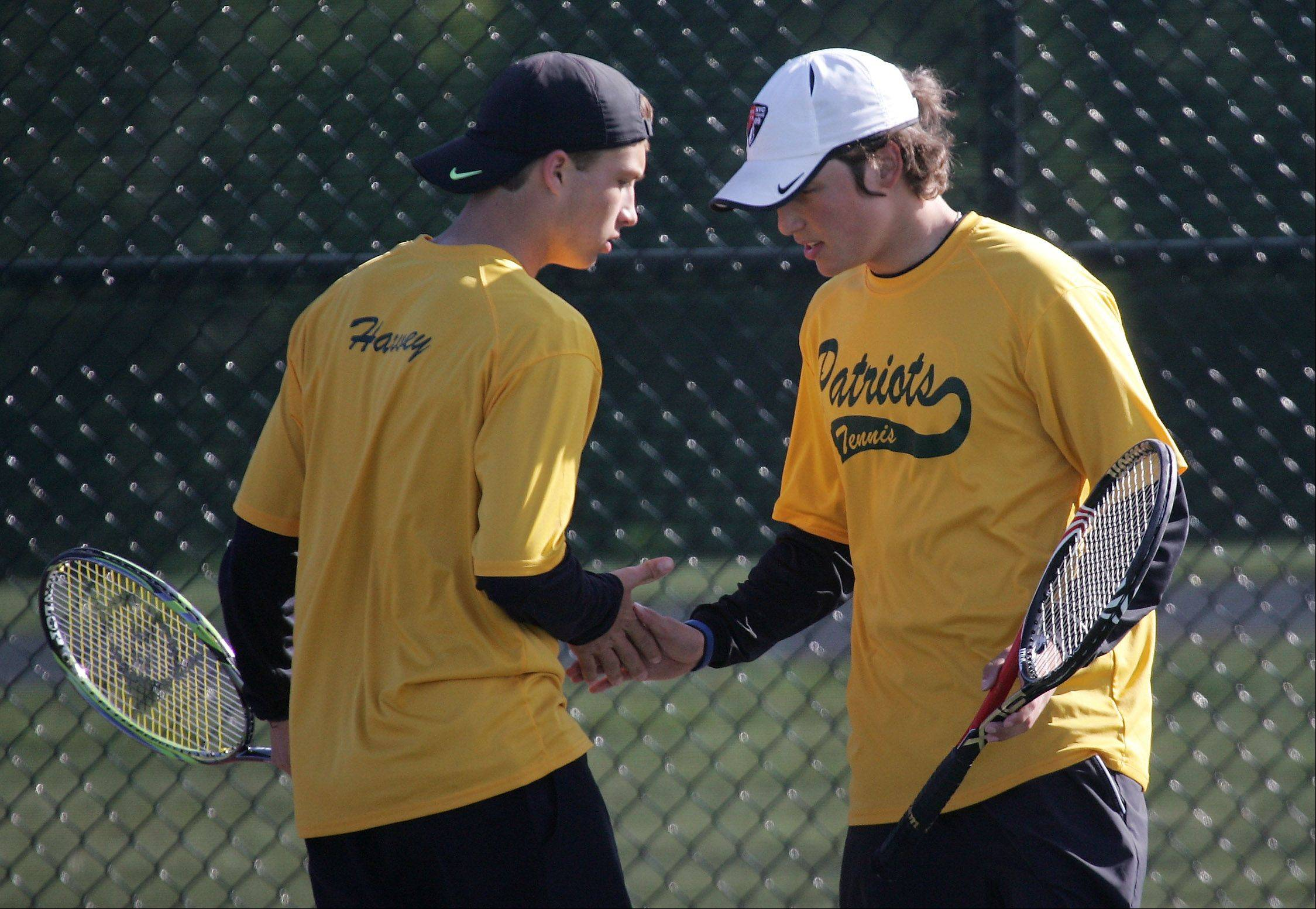 Stevenson's top doubles team -- Colin Harvey, left, and Andrew Komarov -- celebrate after a point Thursday at the Vernon Hills Athletic Complex. The pair faced Lake Forest's team of Camron Bagheri and Connor O'Kelly.