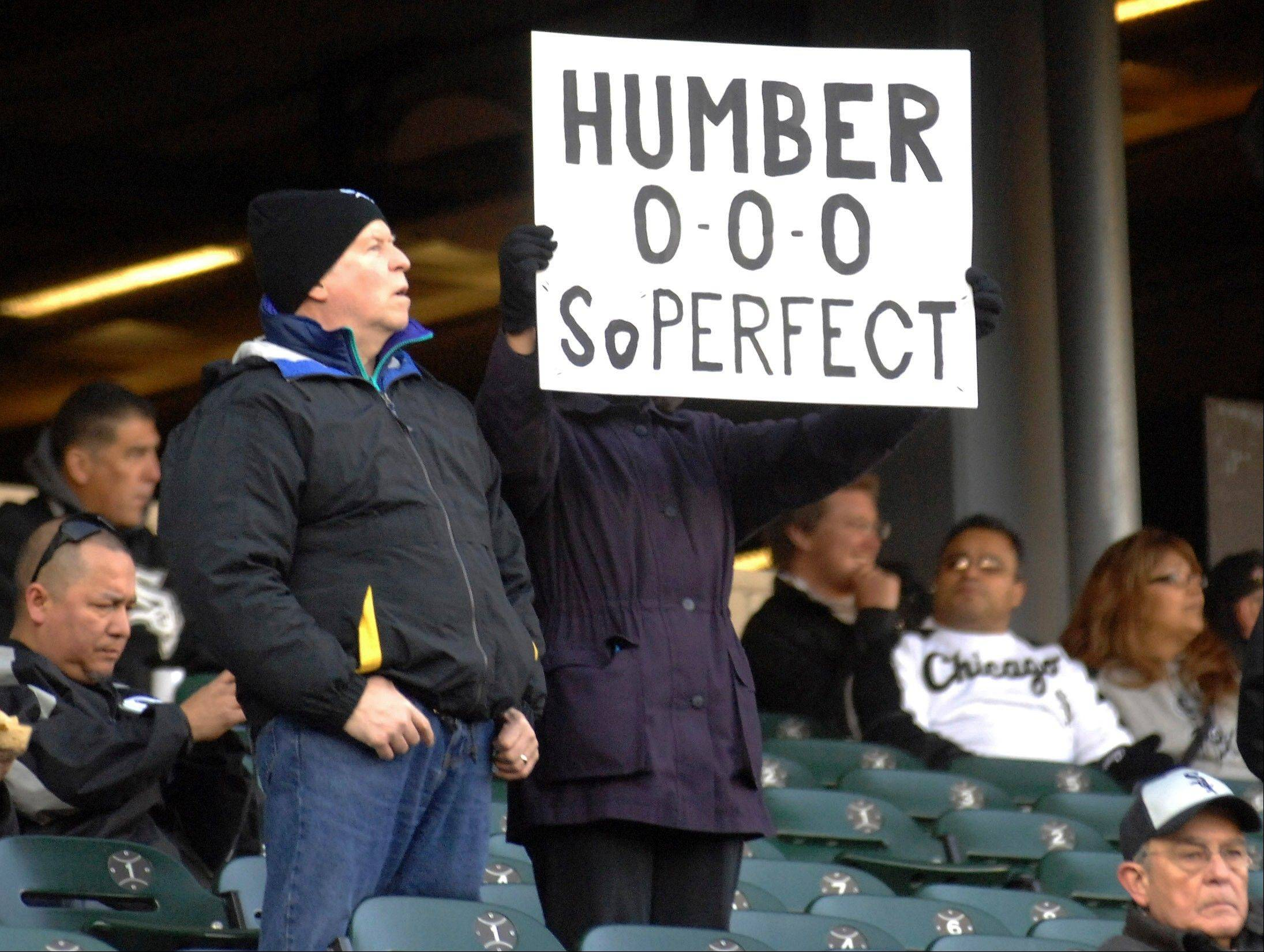 A fan holds up a sign honoring Chicago White Sox starting pitcher Philip Humber's recent perfect game, before the White Sox's baseball game against the Boston Red Sox on Thursday, April 26, 2012, in Chicago. The Red Sox won 10-3.
