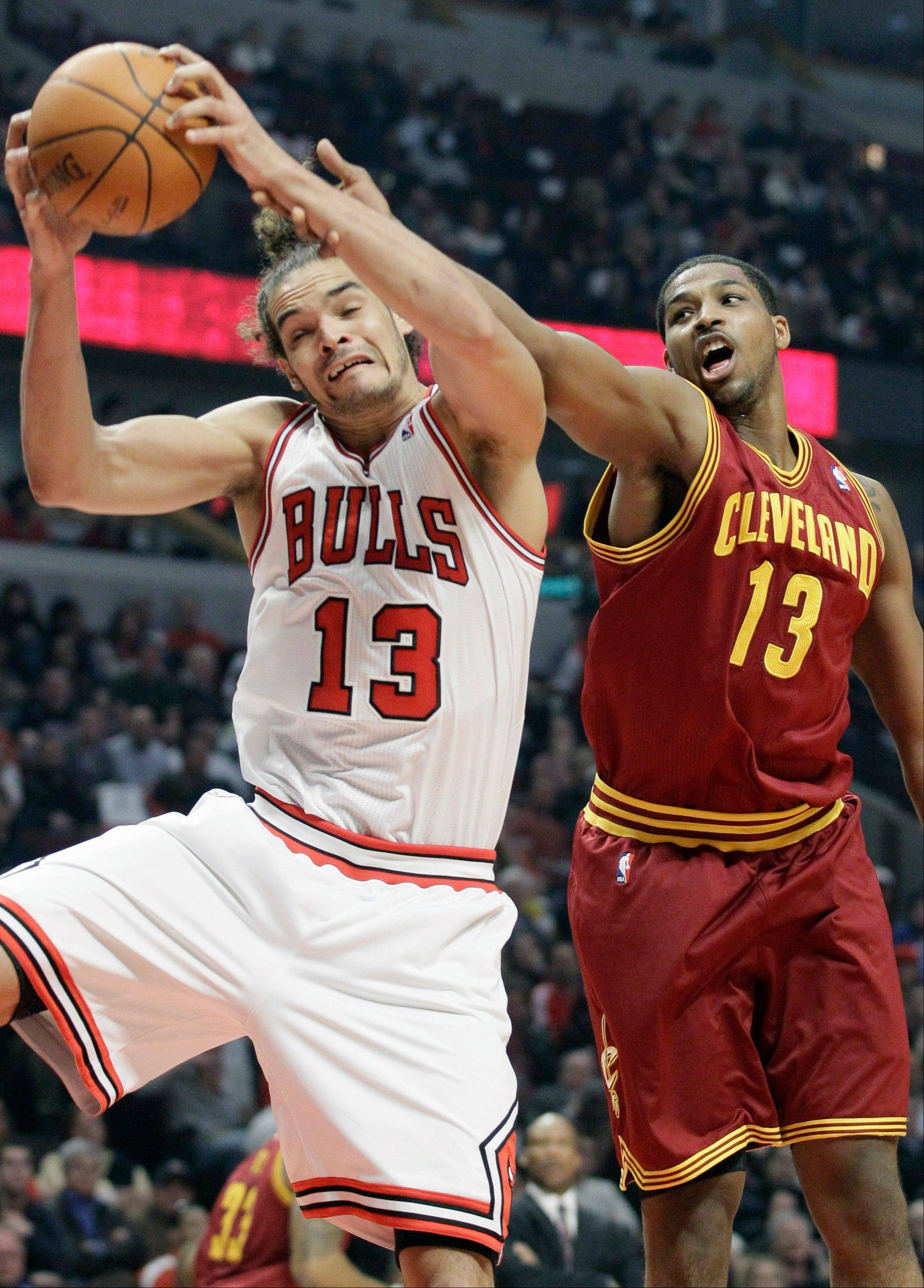 Bulls center Joakim Noah battles for a rebound against Cleveland Cavaliers forward Tristan Thompson Thursday during the first half.