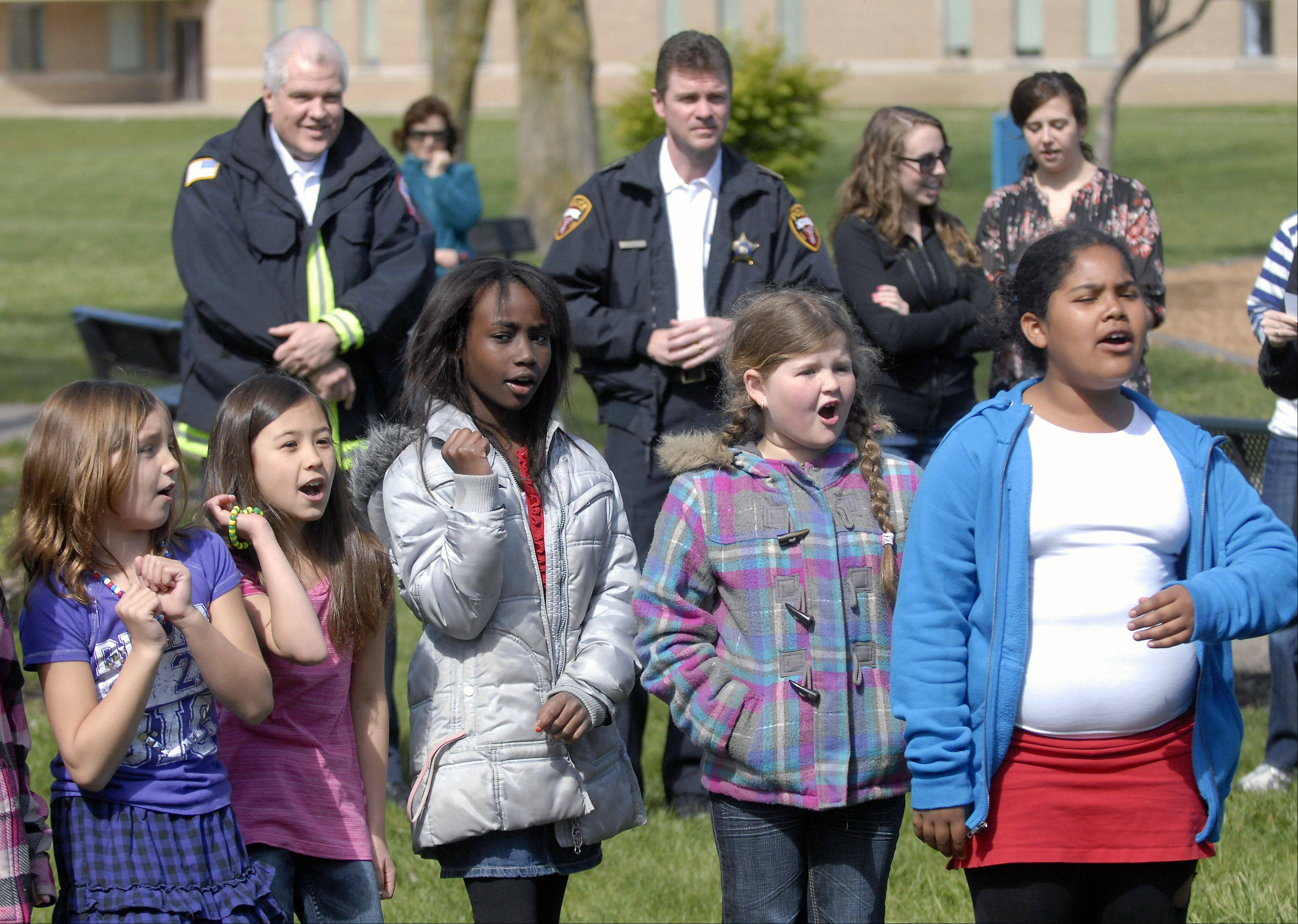 Third-graders sing as Walt Whitman School marks Arbor Day on Friday in Wheeling.