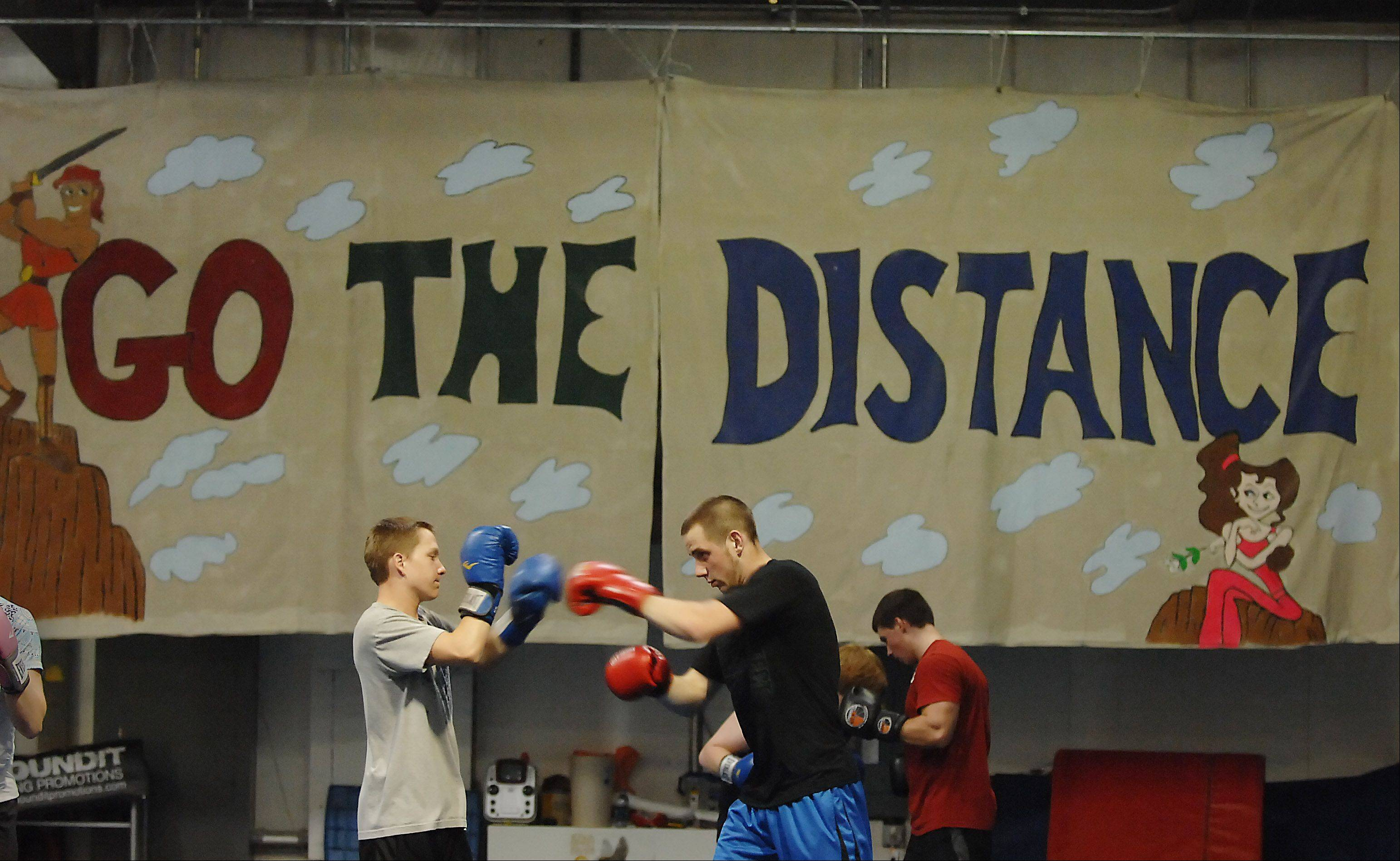 Jimmy Gustafson, left, of Lake in the Hills and Tanner Frese of Cary practice combination punches. Gustafson is boxing in Round 1, an exhibition set for Saturday, April 28, in Lakemoor.