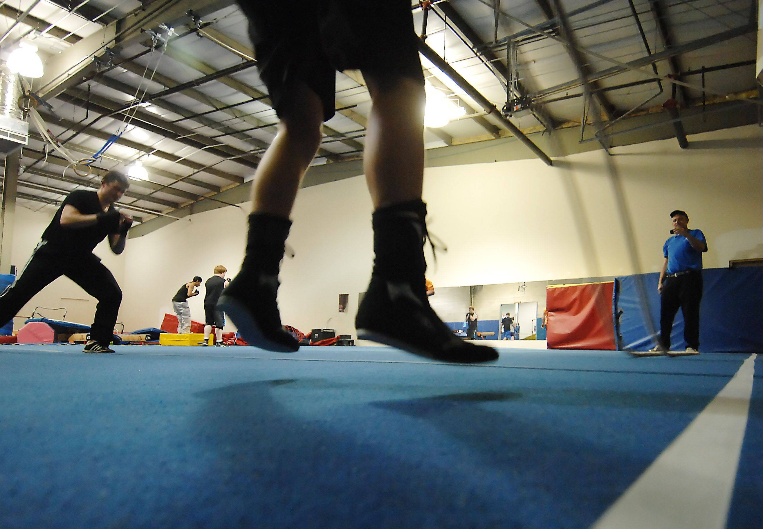 Jimmy Gustafson's boxing shoes lift off the floor as he works out with a heavy rope in Cary. The 16-year-old is boxing in one of several matches Saturday at an event promoted by Paul Jonas of Poundit Boxing Promotions.