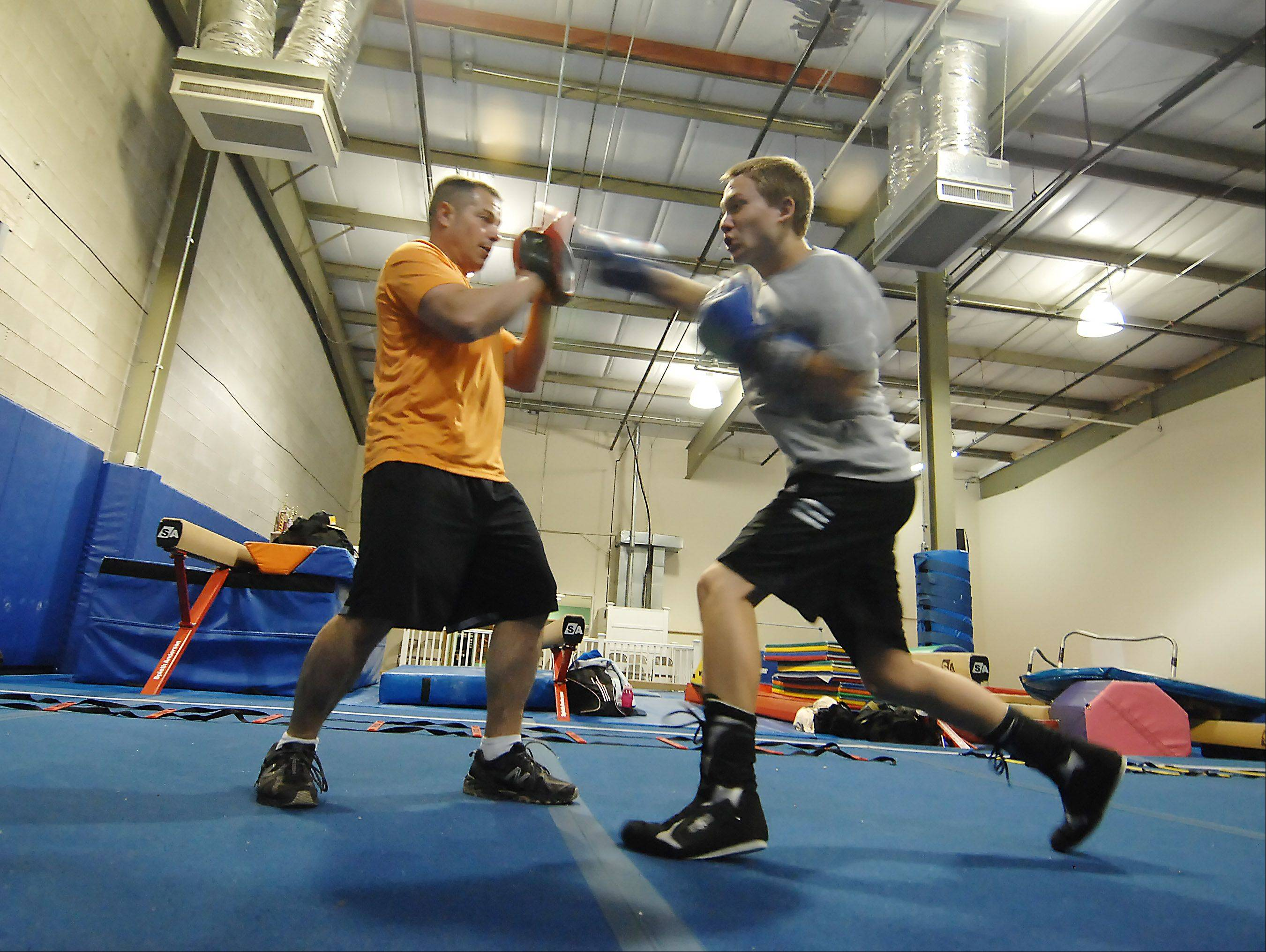 Paul Jonas is launching Poundit Boxing Promotions by having a boxing exhibition this weekend. He coaches several people in the sport each night in Cary, including Jimmy Gustafson, 16, of Lake in the Hills.