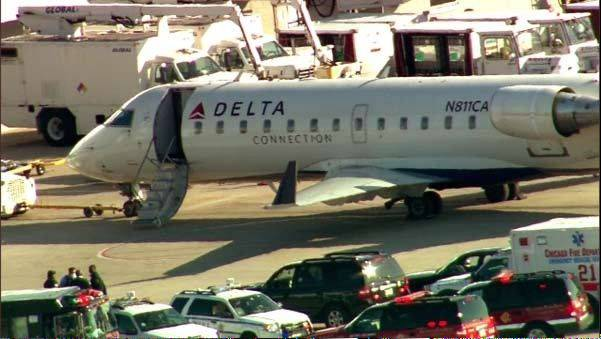 This photo from video shows fire and ambulance crews on the runway at Midway Airport after reports of a medical emergency that led to the quarantine of a Delta airplane Thursday.