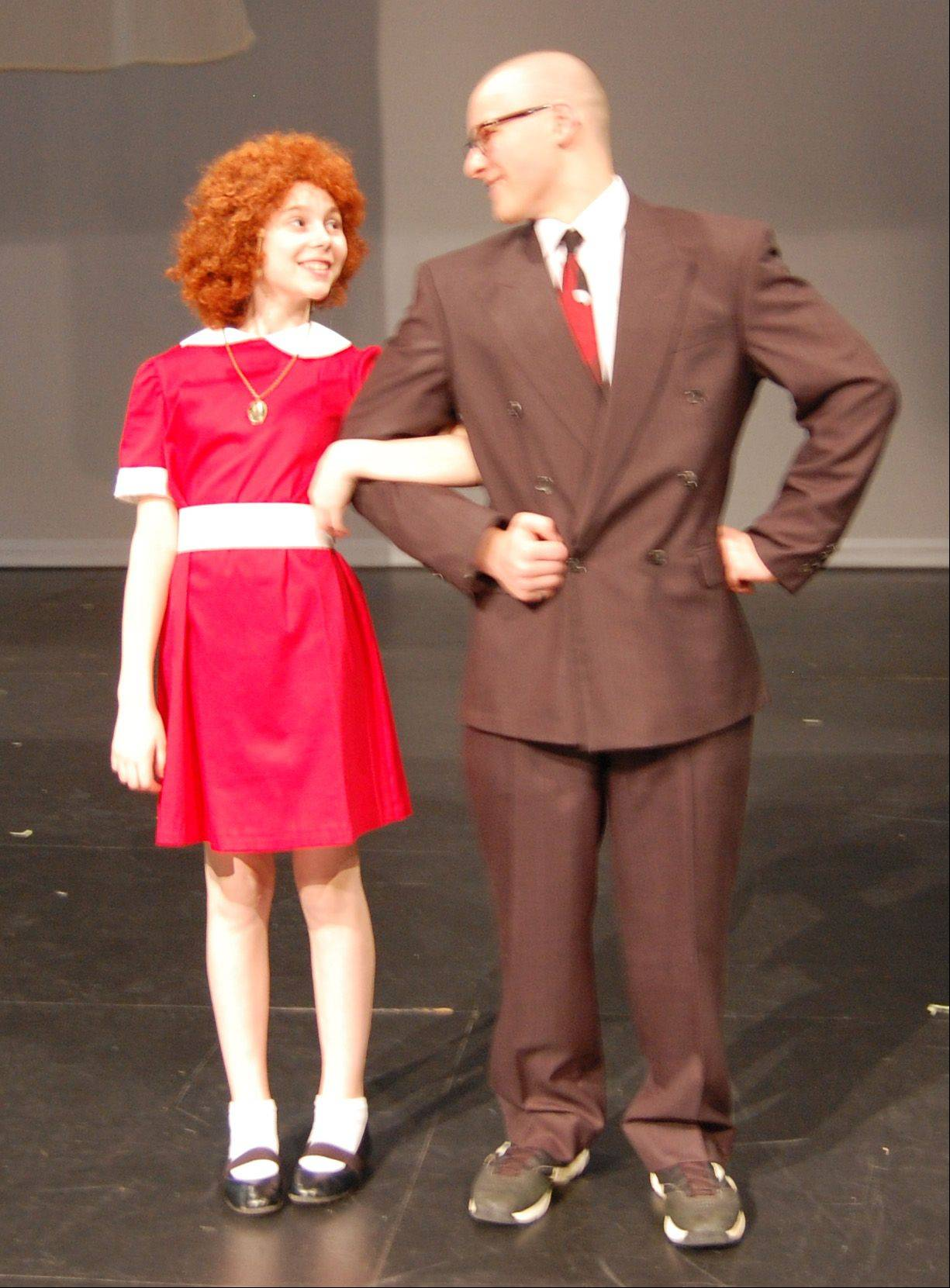 "Dundee Middle School cast members rehearse ""Annie."" Annie is played by seventh-grader Alyssa Weir. Warbucks is played by eighth-grader Bailey Stark."