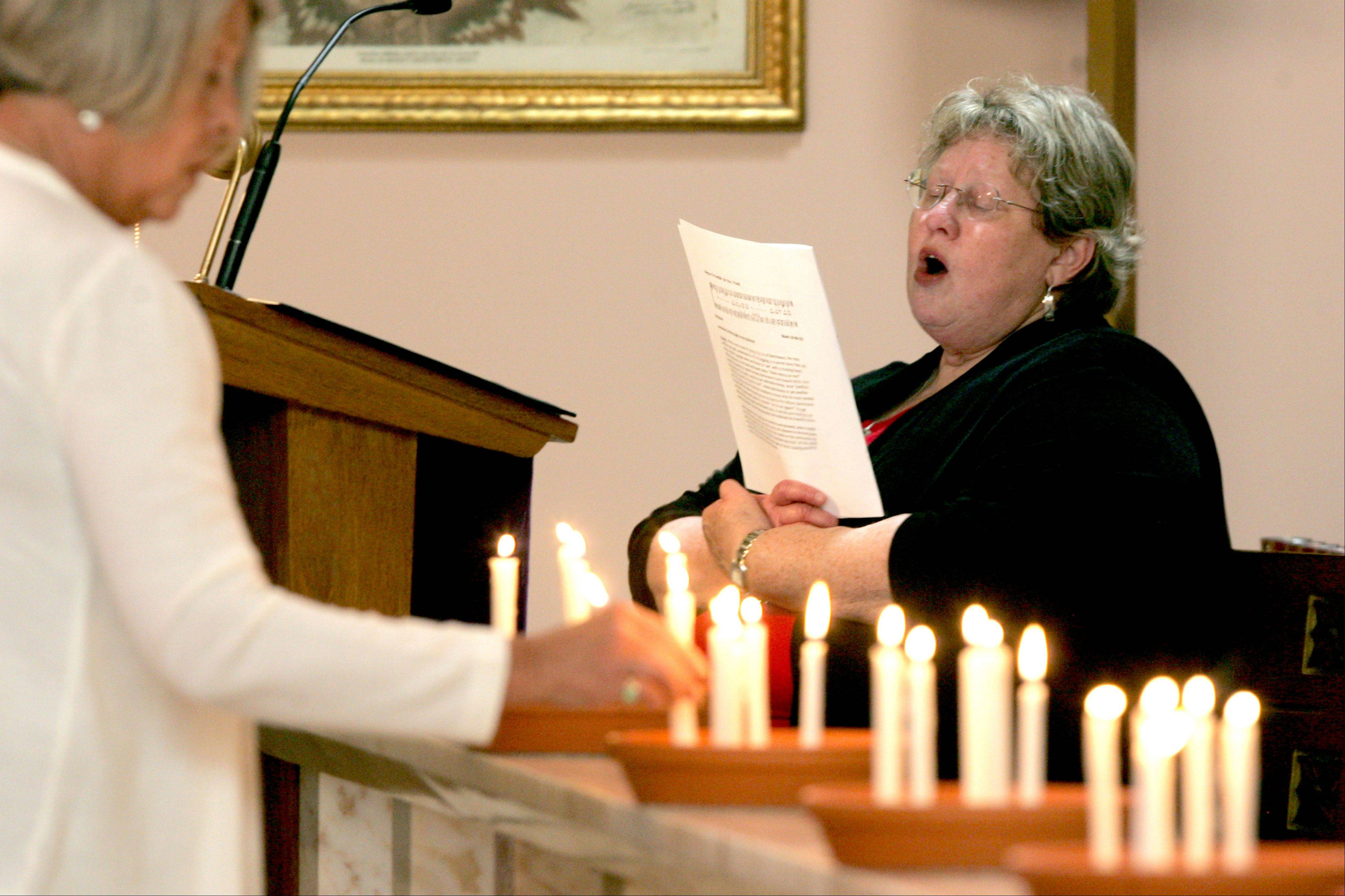 The Rev. Cyndi Gavin, pastor of St. John United Church of Christ Church in Aurora, leads a Taizé service at St. Peter Catholic Church in Aurora.