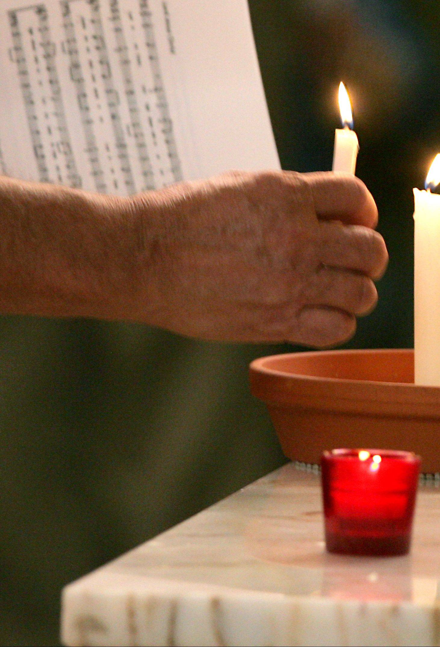 Candles are used during the Taizé service, symbolizing coming out of darkness and into life.
