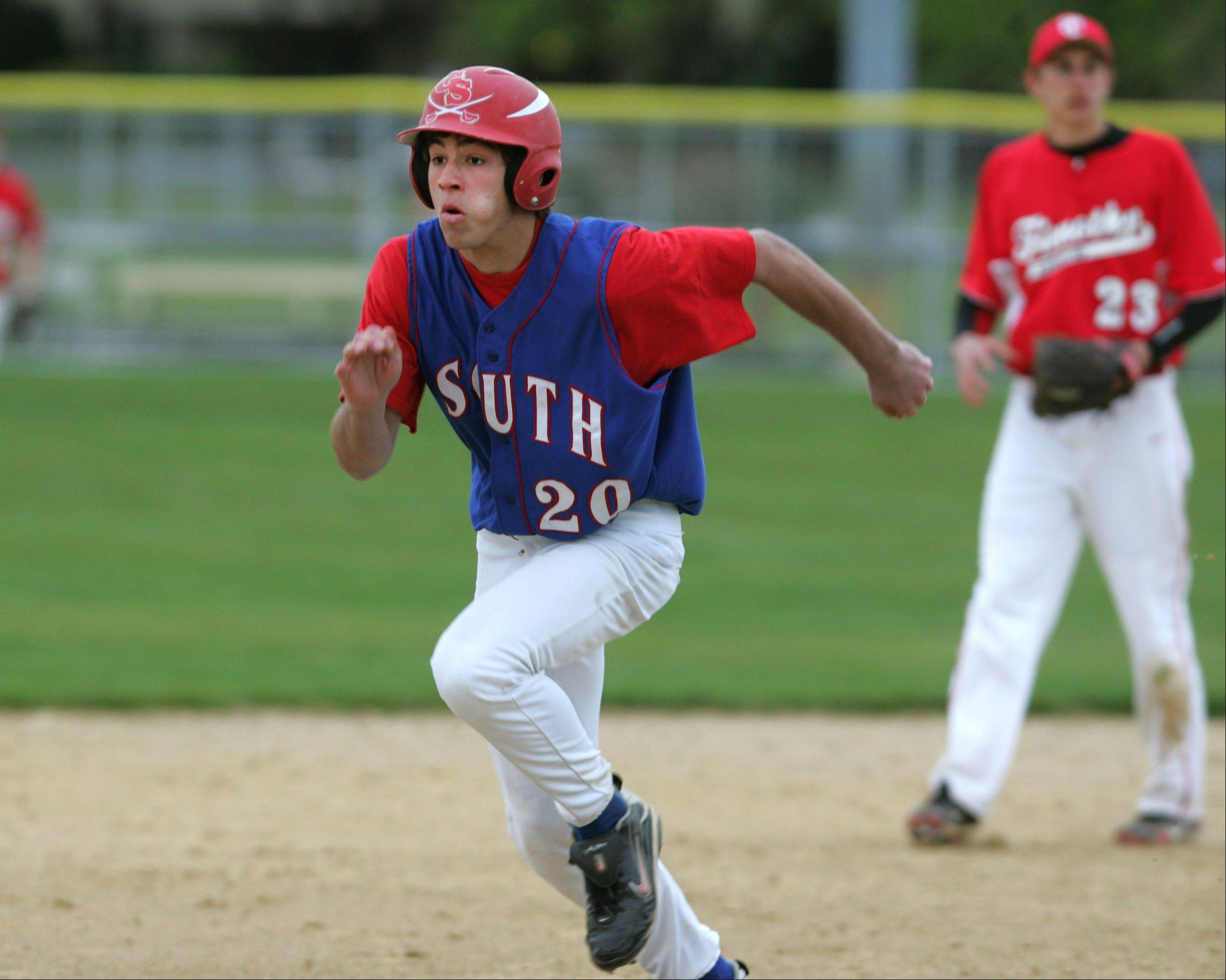 Glenbard South's Steven Straka advances to third base against Timothy Christian, during boys baseball action in Elmhurst.