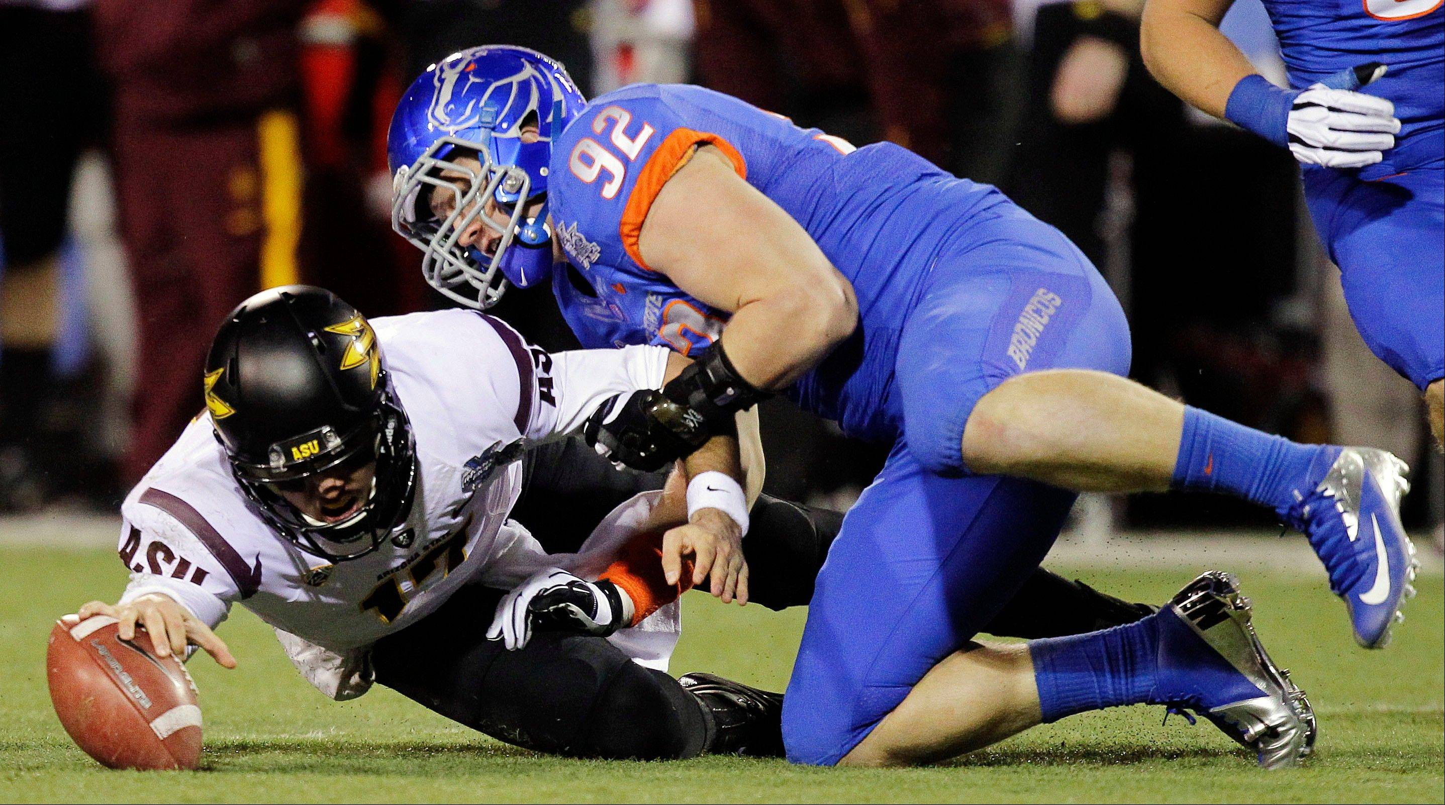 FILE - In this Dec. 22, 2011, file photo, Arizona State quarterback Brock Osweiler (17) reaches for the ball after a bad snap as Boise State defensive end Shea McClellin (92) defends in the first half of the Maaco Bowl NCAA college football game in Las Vegas. McClellin was selected 19th overall by the Chicago Bears in the first round of the NFL football draft at Radio City Music Hall, Thursday, April 26, 2012, in New York.