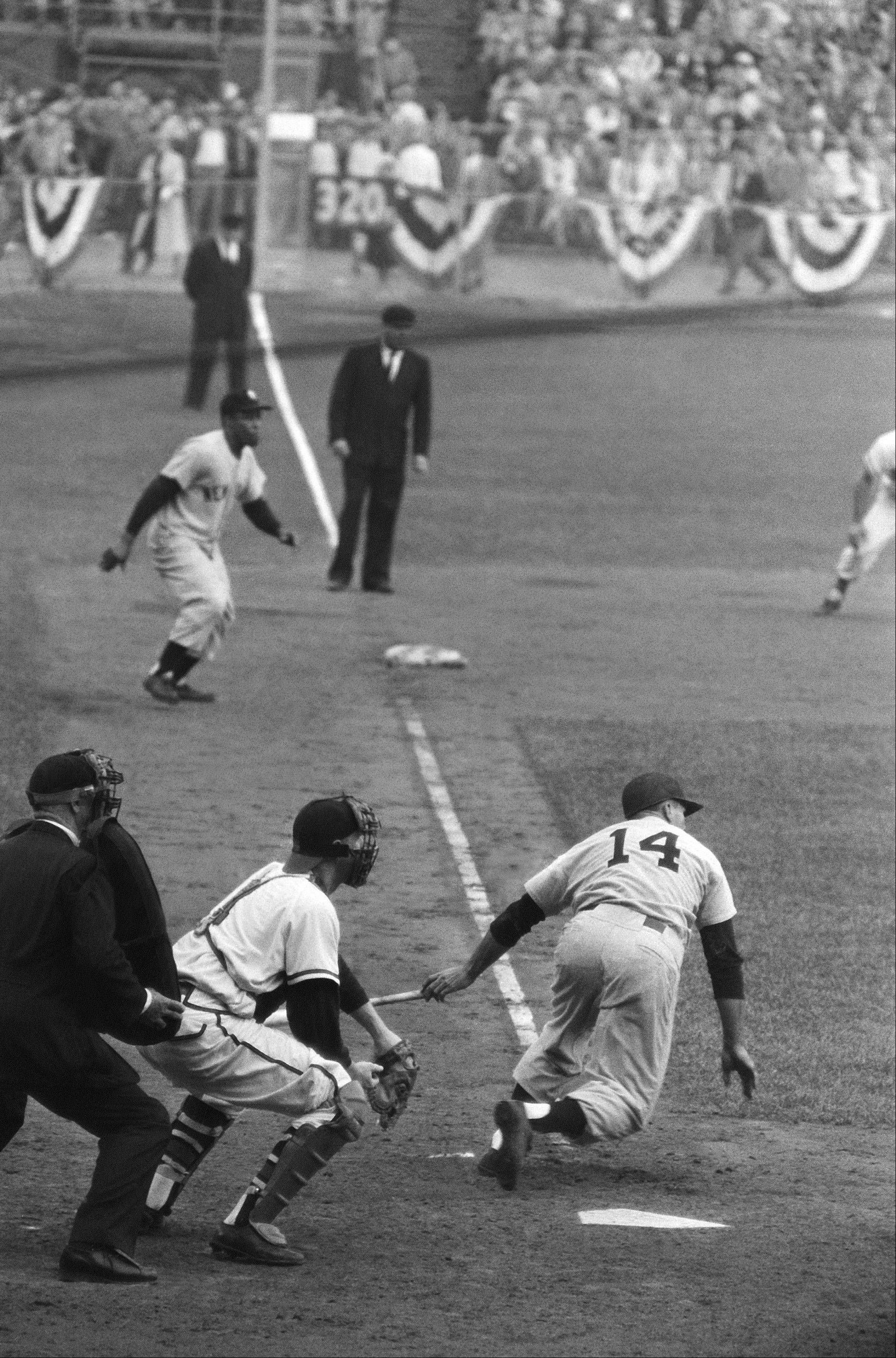 Moose Skowron (14) heads for first in 10th inning in Milwaukee, Oct. 8, 1958, after hitting single to right that gave Yanks 4-3 Series victory. Elston Howard, Yanks, is on way down third base line to score on the hit. At plate are umpire Charlie Berry and catcher Del Crandall. Umpire beyond Howard is Al Barlick.