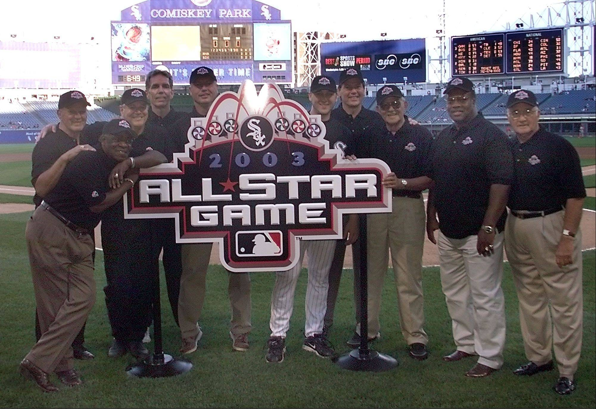Former and current Chicago White Sox All-Stars, from left, Minnie Minoso (leaning on sign), Bill Skowron, Bill Melton, Ed Farmer, Ron Kittle, Mark Buehrle, Carlton Fisk, Chico Carrasquel, Carlos May and Billy Pierce pose with the logo for the 2003 All-Star Game before the White Sox's game against the Anaheim Angels at Comiskey Park in Chicago, Wednesday, Aug. 7, 2002.