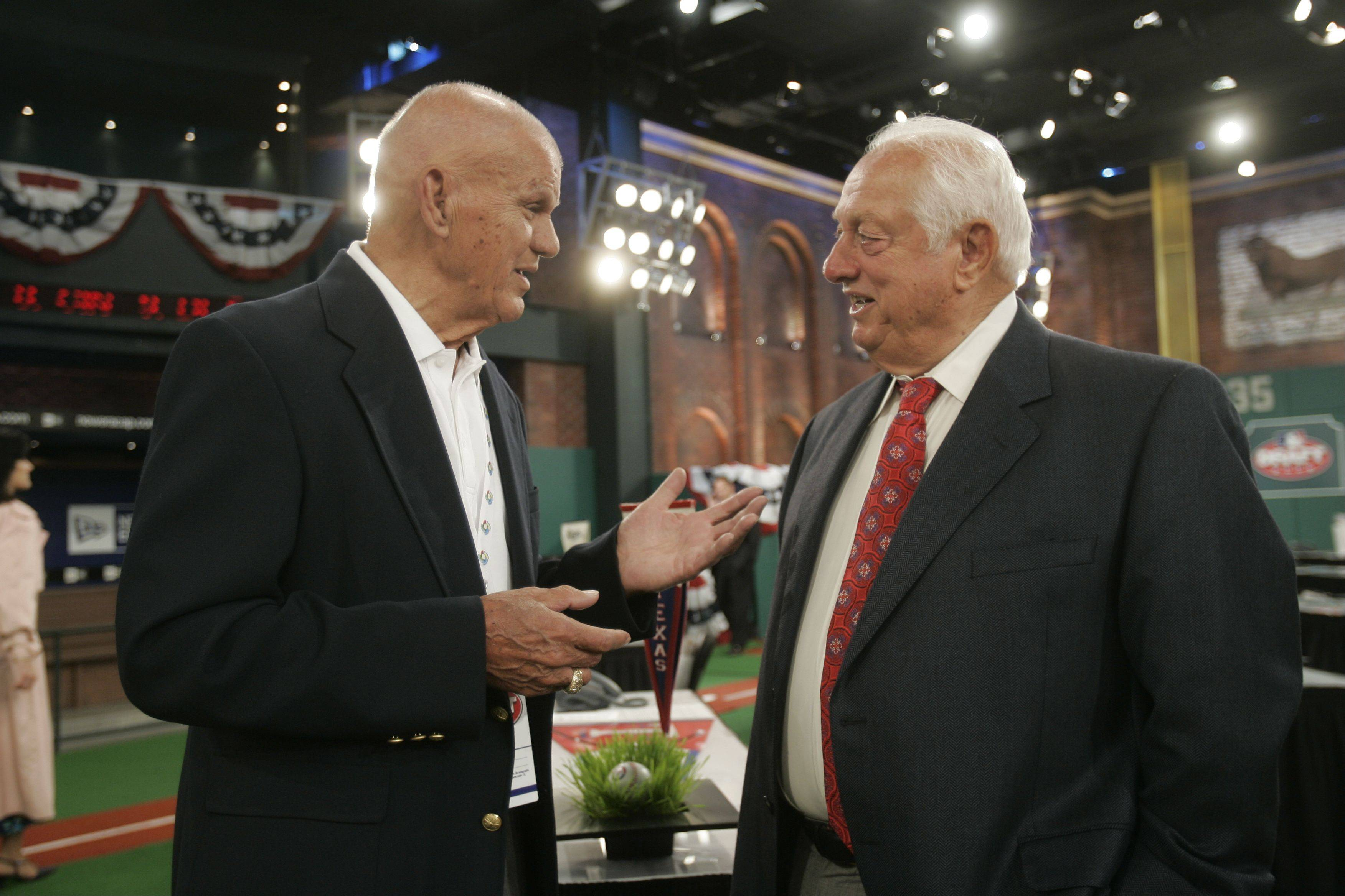 Former baseball player Moose Skowron talks with Dodgers executive and former manager Tommy Lasorda before the start of the baseball draft at MLB Network Studios in Secaucus, N.J., Tuesday, June 9, 2009.