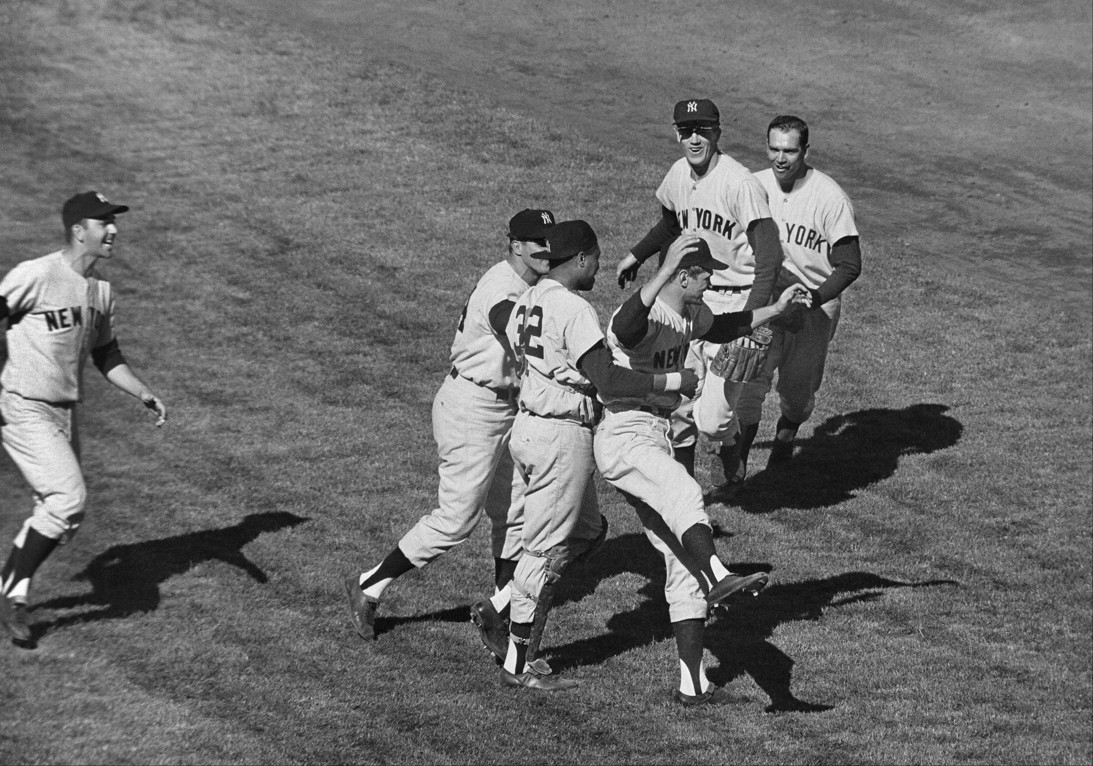 Yankees players celebrate at Candlestick Park, after beating the San Francisco Giants 1-0 in Game 7 of the World Series, Oct. 16, 1962. In group at center, first baseman Bill Skowron, left, and catcher Elston Howard (32) rush winning pitcher Ralph Terry. In background are shortstop Tony Kubek, left, and second baseman Bobby Richardson.