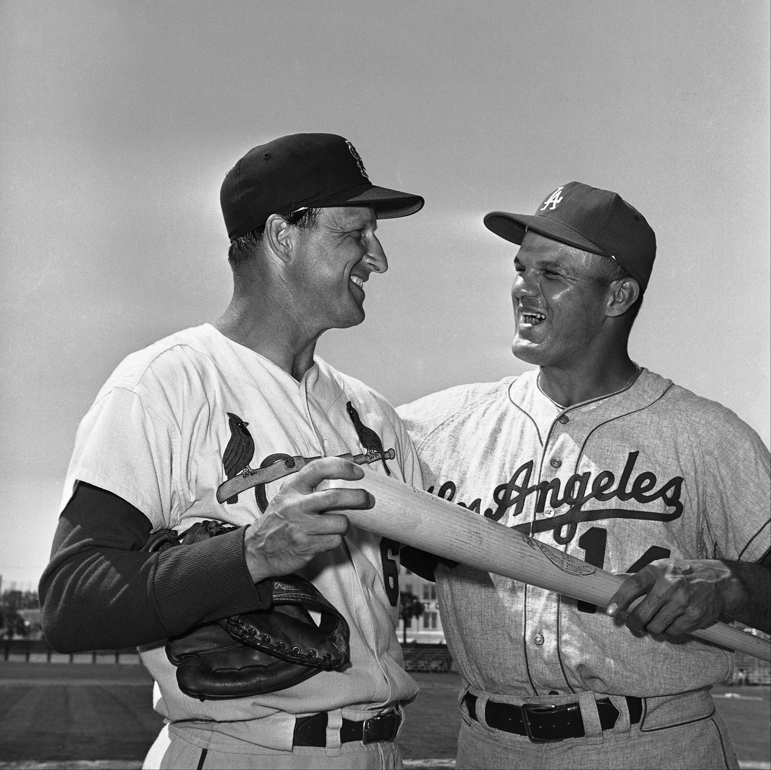 Stan Musial of the St. Louis Cardinals exchanges pleasantries with Bill Skowron of the Los Angeles Dodgers on March 13, 1963 in St. Petersburg before exhibition game. Skowron was traded from the New York Yankees for pitcher Stan Williams.
