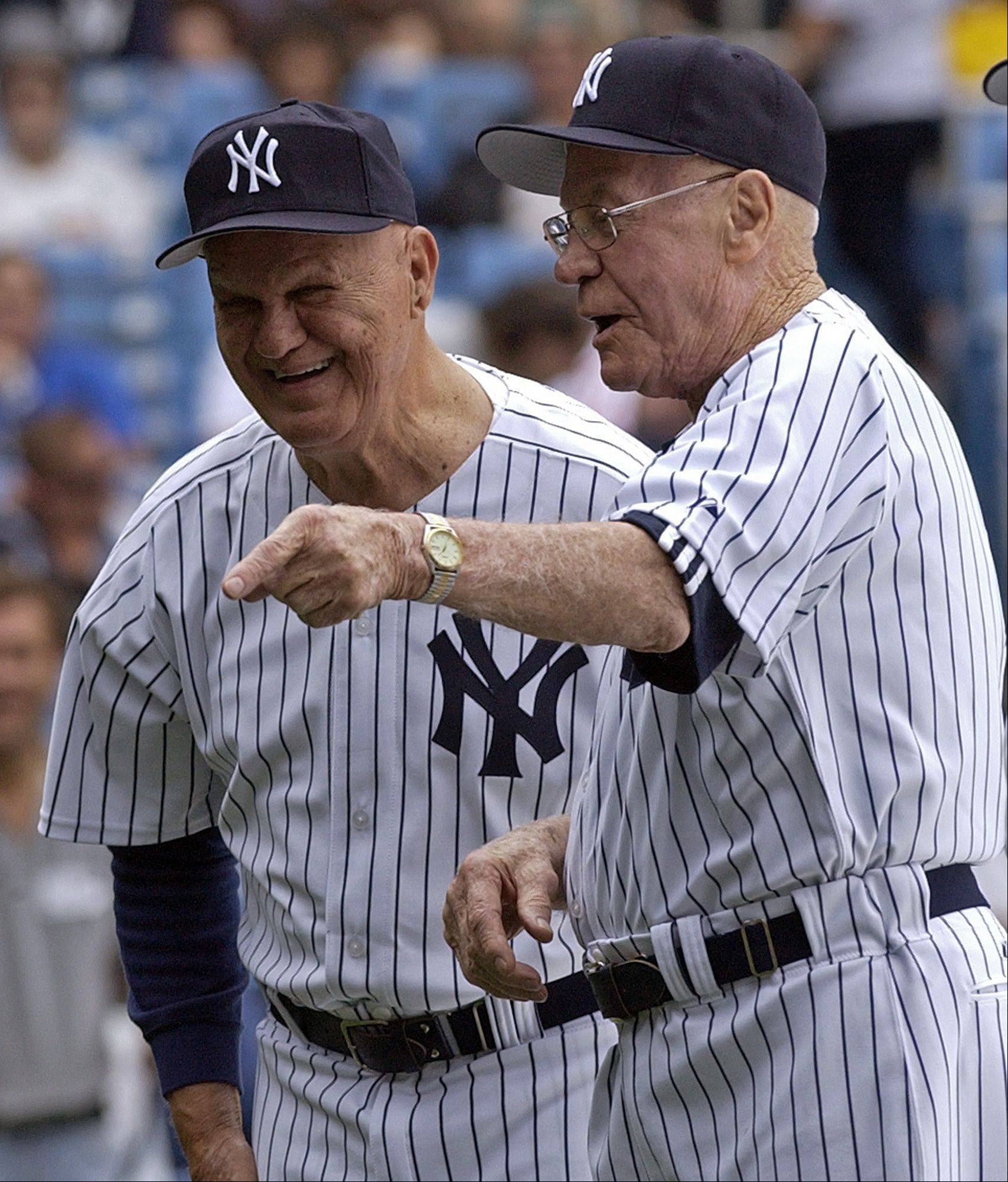 New York Yankees' Hank Bauer, right, and Moos Skowron are shown during old-timer's day at New York's Yankee Stadium in this June 24, 2006 file photo.