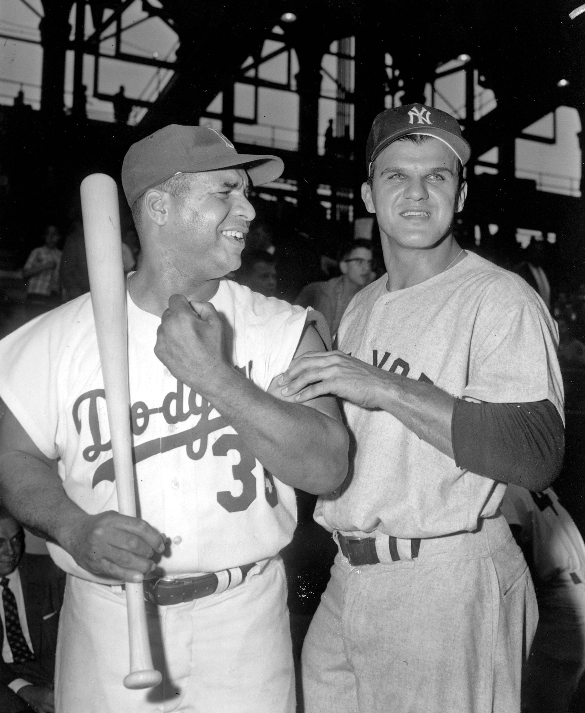 In this May 23, 1959, file photo, Moose Skowron, right, first baseman of the New York Yankees, jokes with Roy Campanella about his muscles after the Brooklyn Dodgers catcher won the pre-game hitting contest at Ebbets Field in the Brooklyn borough of New York. Campanella hit 5 homers to Skowron's 4 in competition held before start of 11th annual Mayor's trophy game. Skowron, a four-time All-Star first baseman who helped the Yankees win four World Series titles in the 1950s and 1960s, died Friday, April 27, 2012, at Northwest Community Hospital in Arlington Heights, Ill. He was 81.