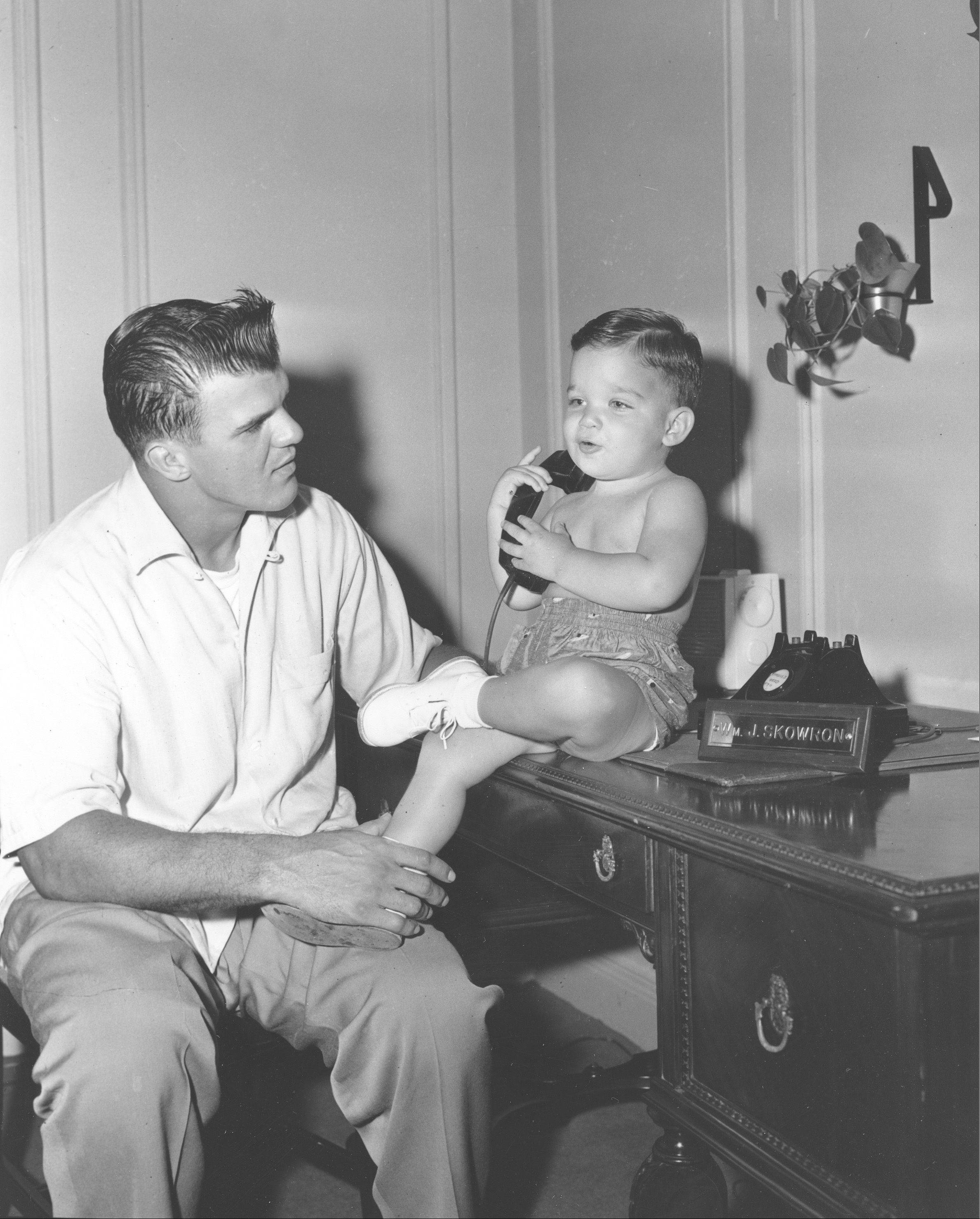 New York Yankees first baseman William J. Skowron is shown with his son at their Concourse Plaza Hotel home in New York City, Aug. 5, 1955.