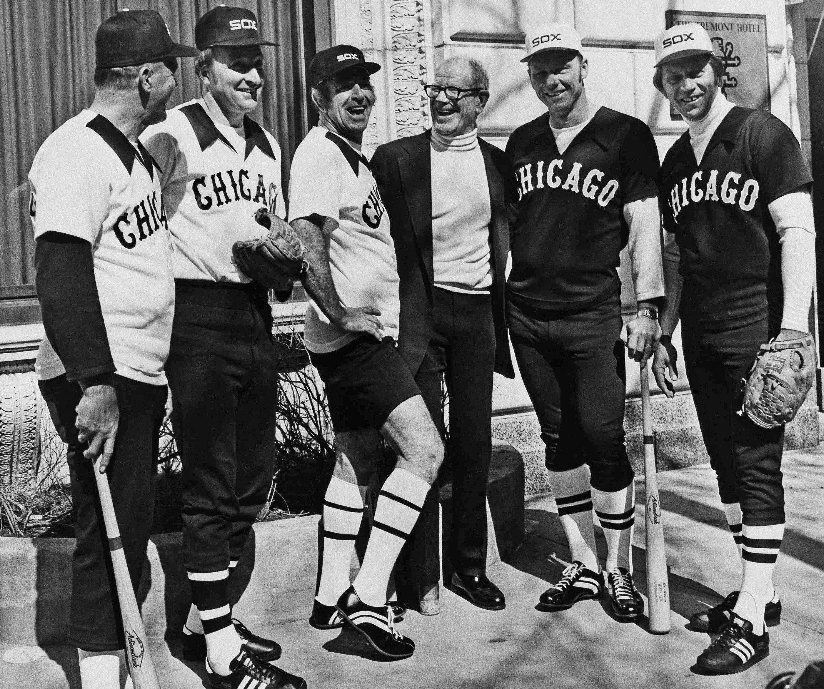"Five retired MaJor League ball players appear in Chicago, Tuesday, March 10, 1976, with Chicago White Sox owner Bill Veeck as they showed new uniforms that the White Sox will be wearing this season. Three home game uniforms at left are worn by (from left) Bill ""Moose"" Skowron, Mo Drabowski and Jim K. Rivera, wearing home hot weather uniforms. At right are the road uniforms worn by Dave Nicholson and Dan Osinski."