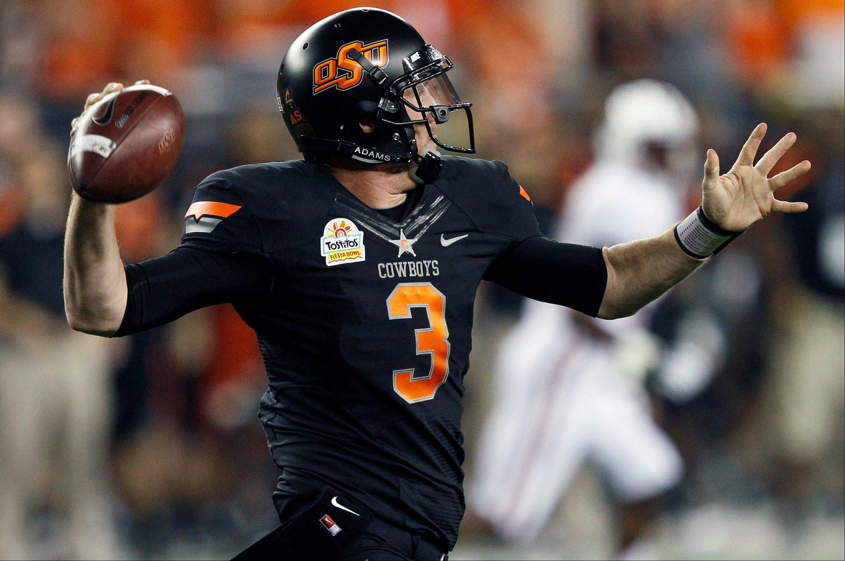 Oklahoma State quarterback Brandon Weeden was selected as the 22nd pick overall by the Cleveland Browns in the first round of the NFL Draft at Radio City Music Hall.