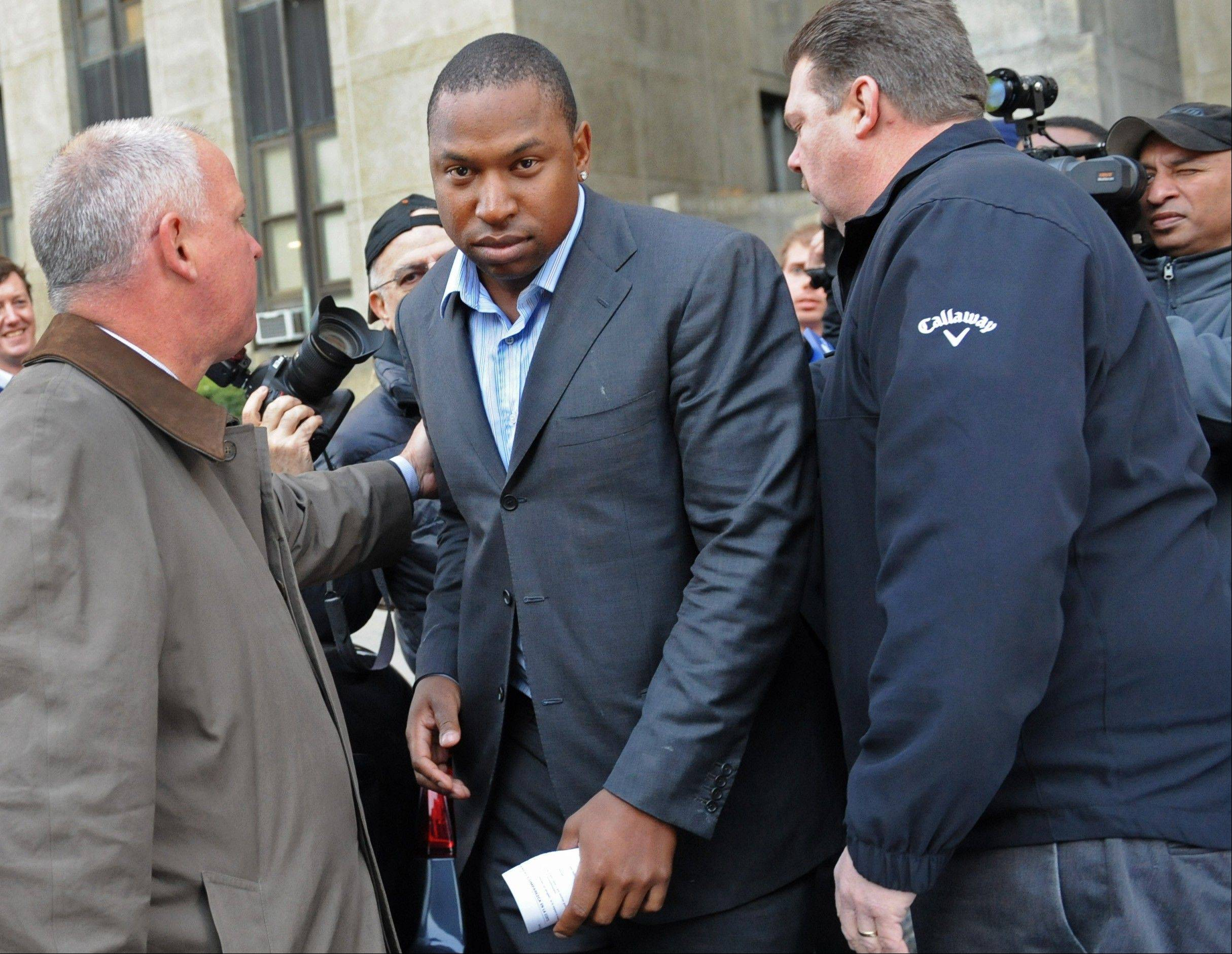 Detroit Tigers left fielder Delmon Young, center, exits Manhattan criminal court after posting bail on Friday in New York. Police say Young got into a fight with a group of men early Friday outside the team's midtown Manhattan hotel and yelled anti-Semitic epithets.