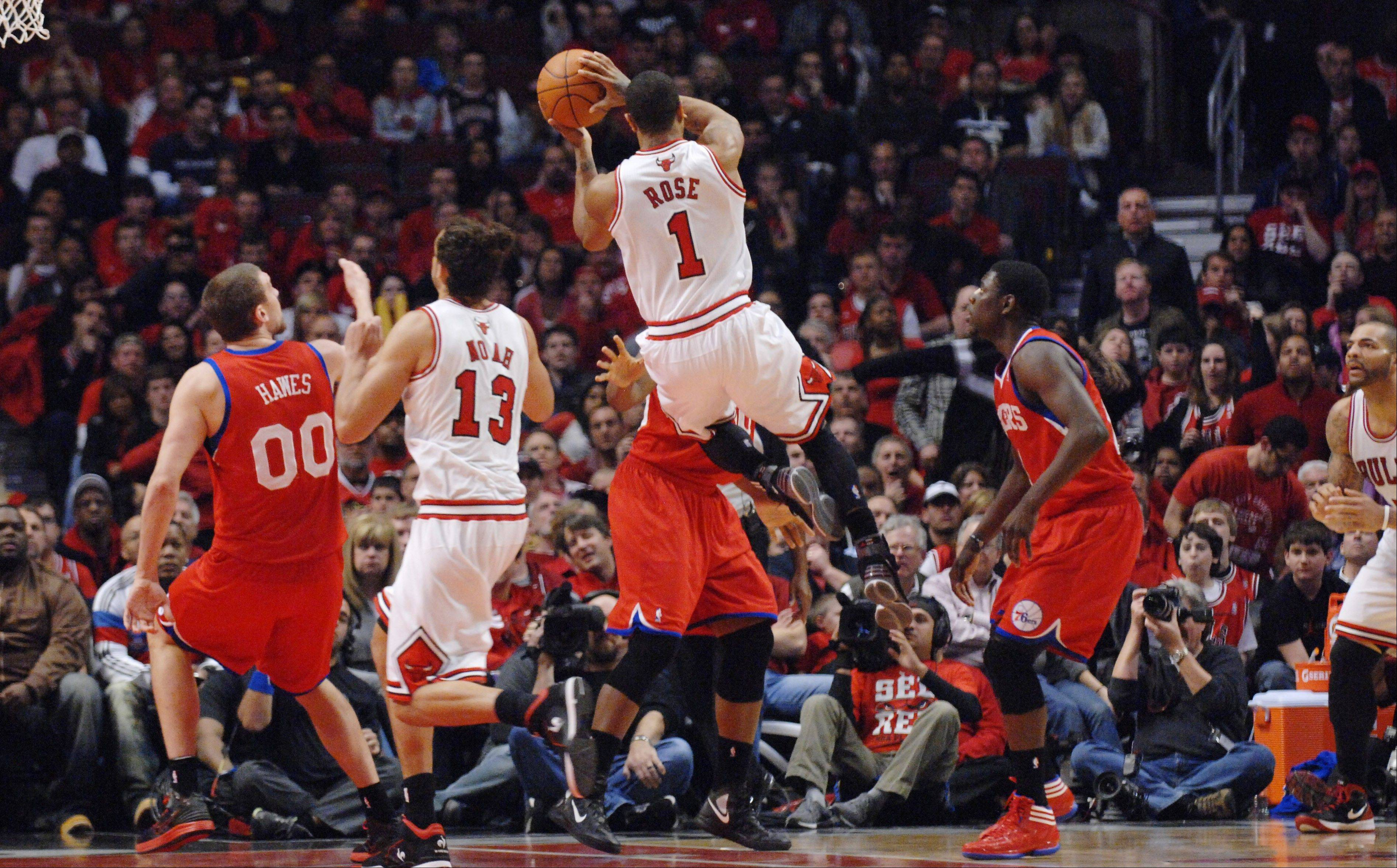 Derrick Rose goes up for shot as he injures the ACL in his left leg Saturday at the United Center.