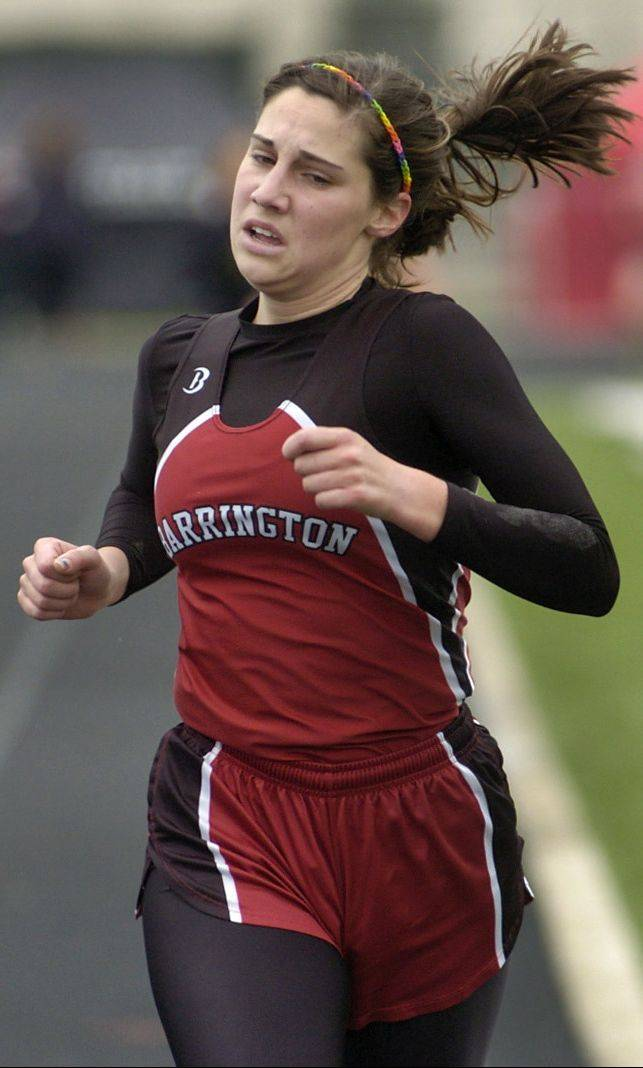 Elizabeth Tracy of Barrington heads for a second-place finish in the 3,200-meter run at the Palatine Relays on Saturday. The Fillies won the team title.