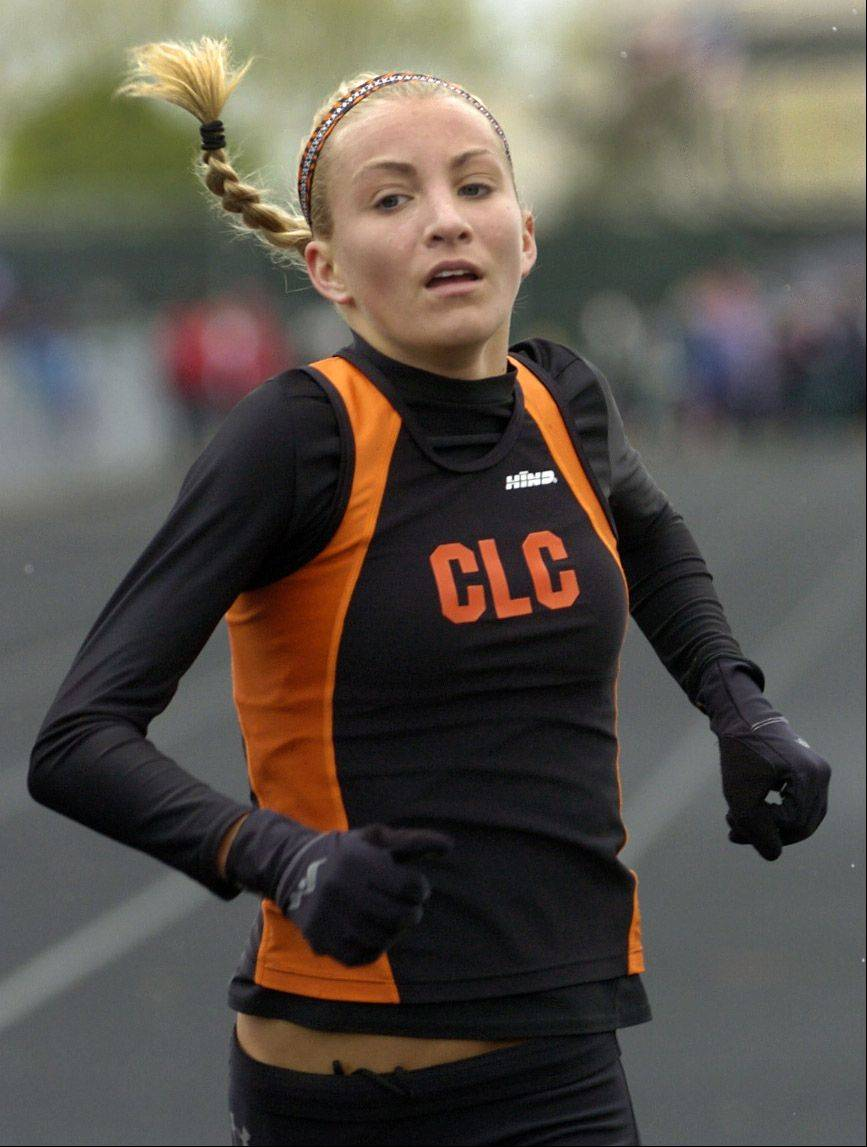 Sami Staples of Crystal Lake Central wins convincingly the 3,200-meter run at the Palatine Relays on Saturday.