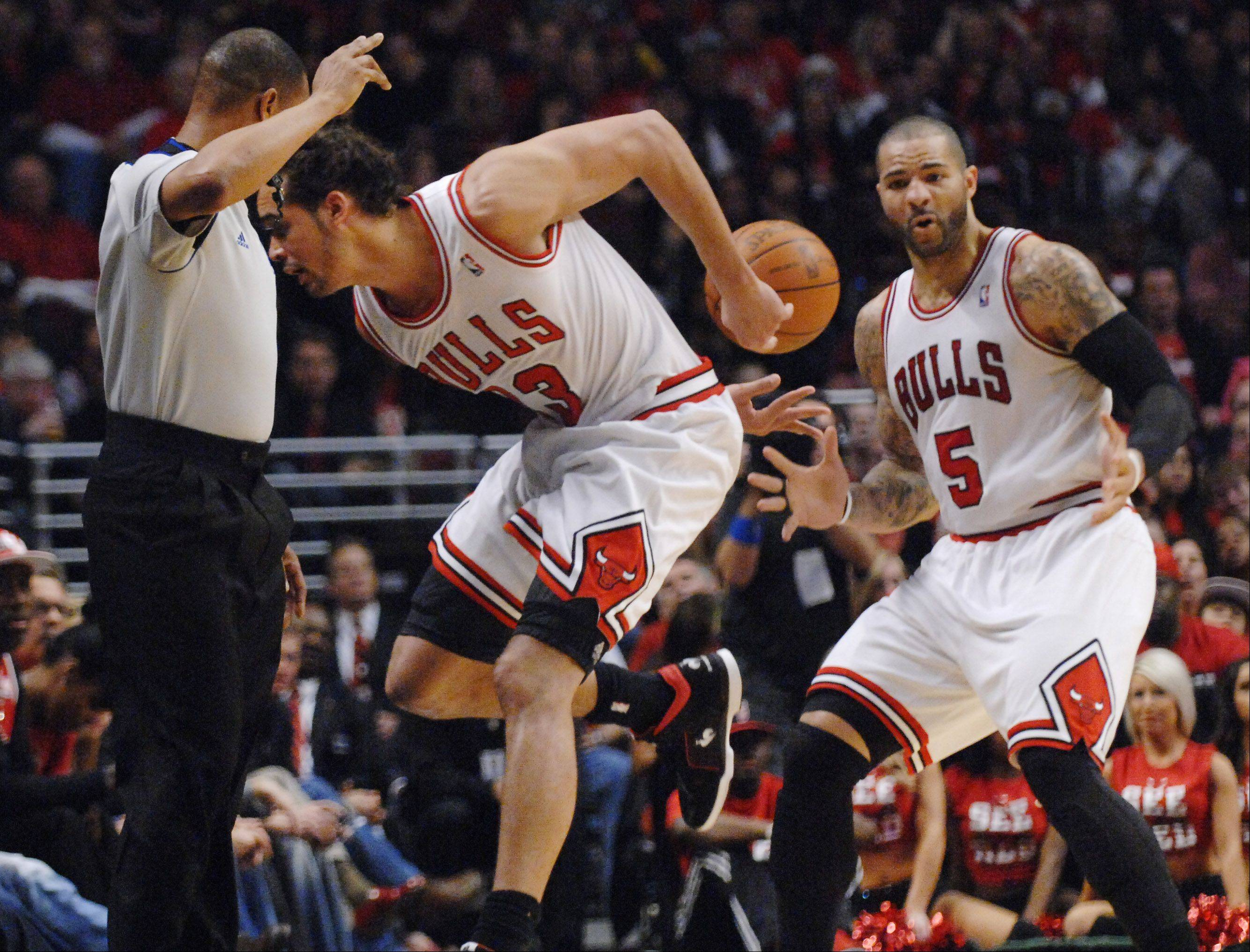 Chicago Bulls center Joakim Noah saves the ball from going out of bounds and flips it to forward Carlos Boozer.