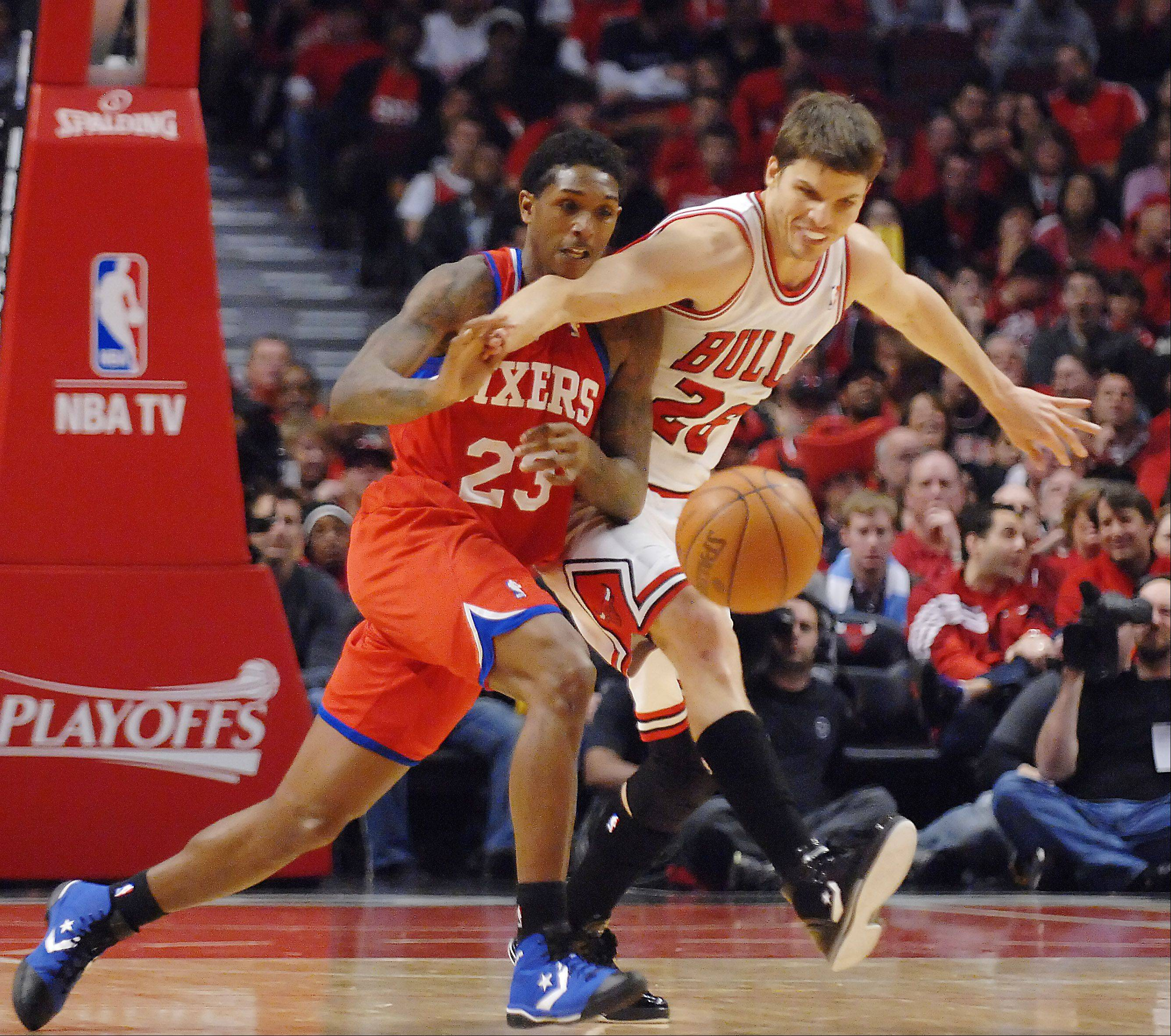 Philadelphia 76ers point guard Lou Williams steals the ball from Chicago Bulls small forward Kyle Korver.