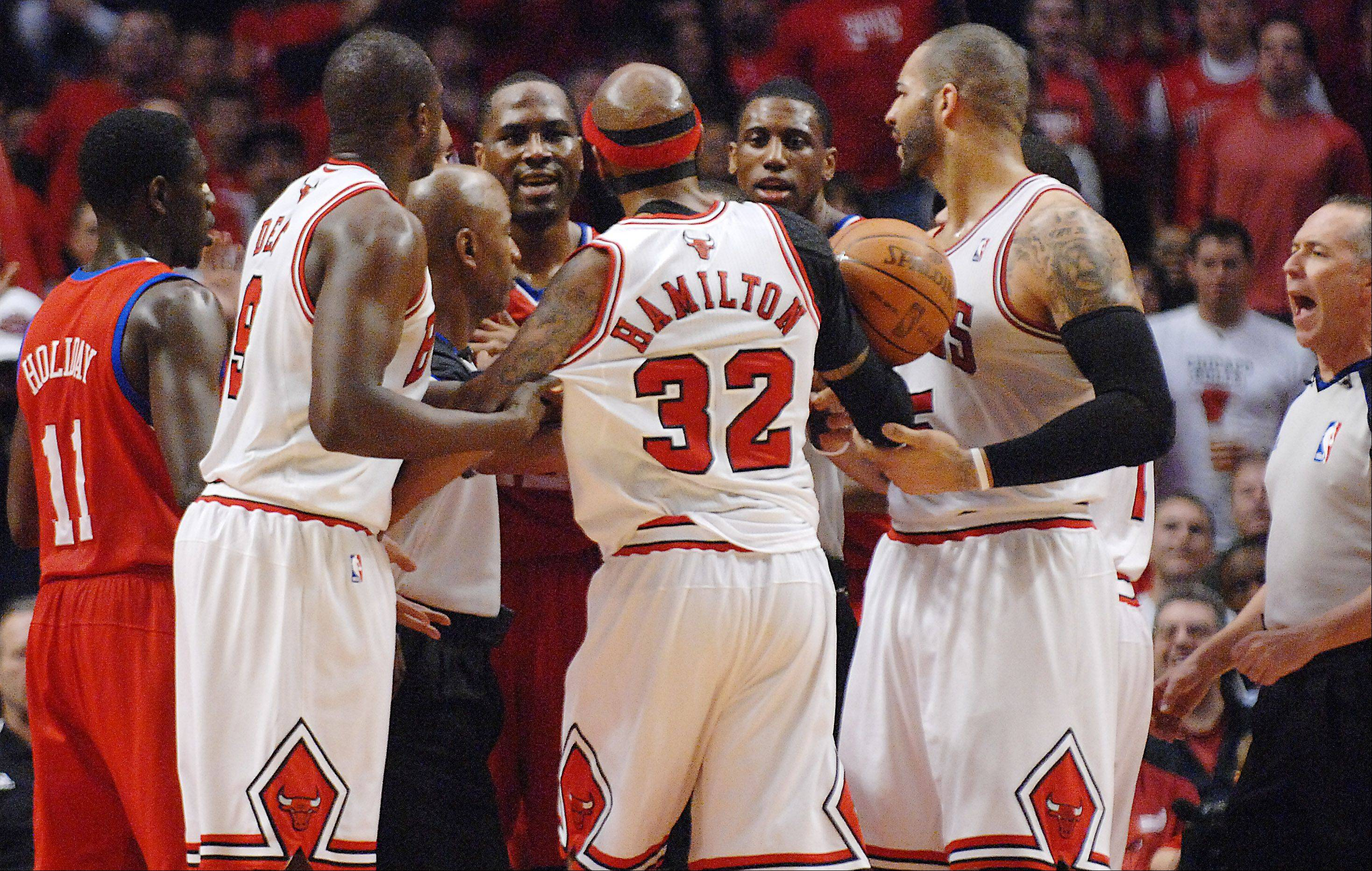 A scuffle occurs Saturday in the first game of the first round of the Eastern Conference Playoffs at the United Center in Chicago. Three technical fouls were issued, two of them on the Bulls.