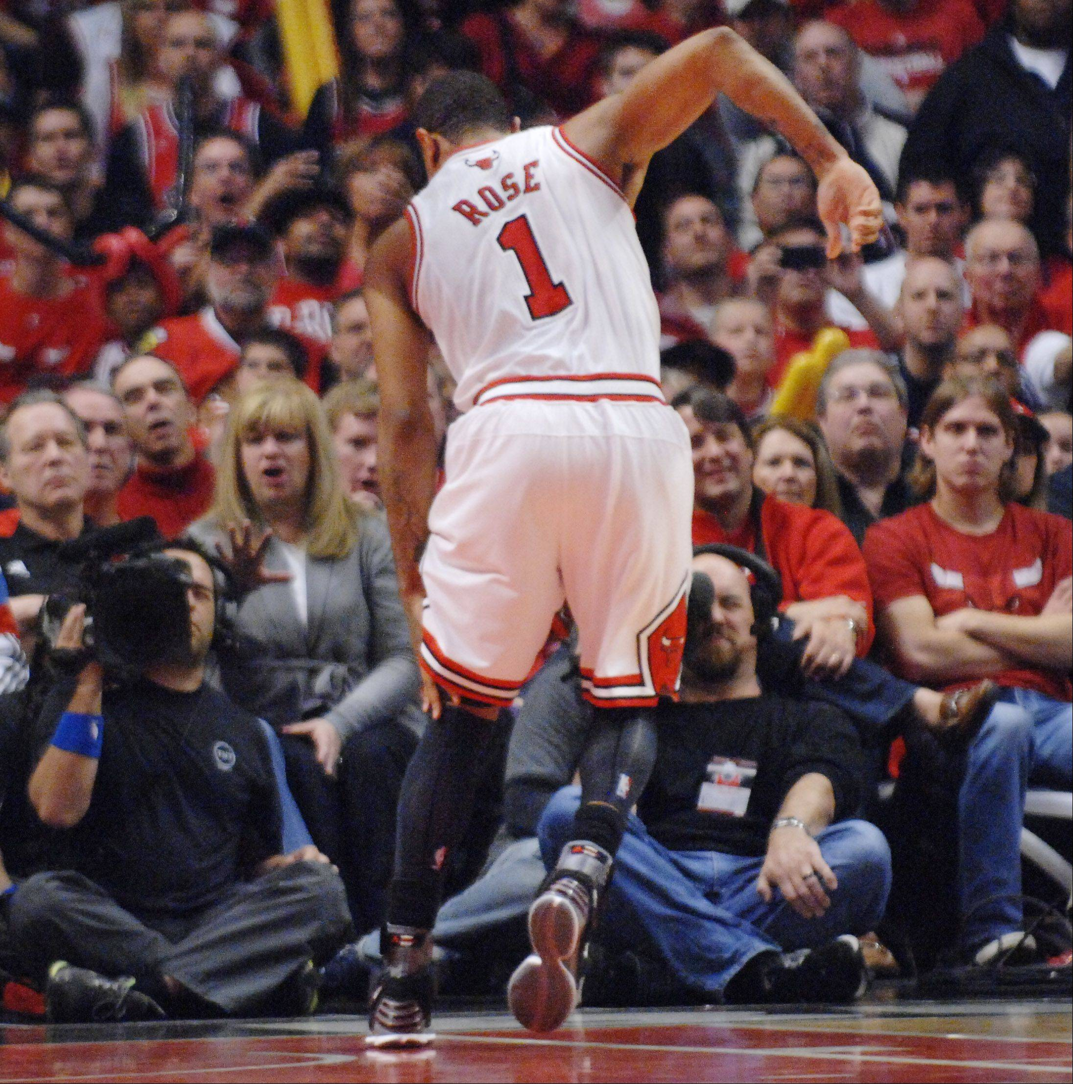 Chicago Bulls point guard Derrick Rose limps to the baseline after injuring his leg in the fourth quarter.