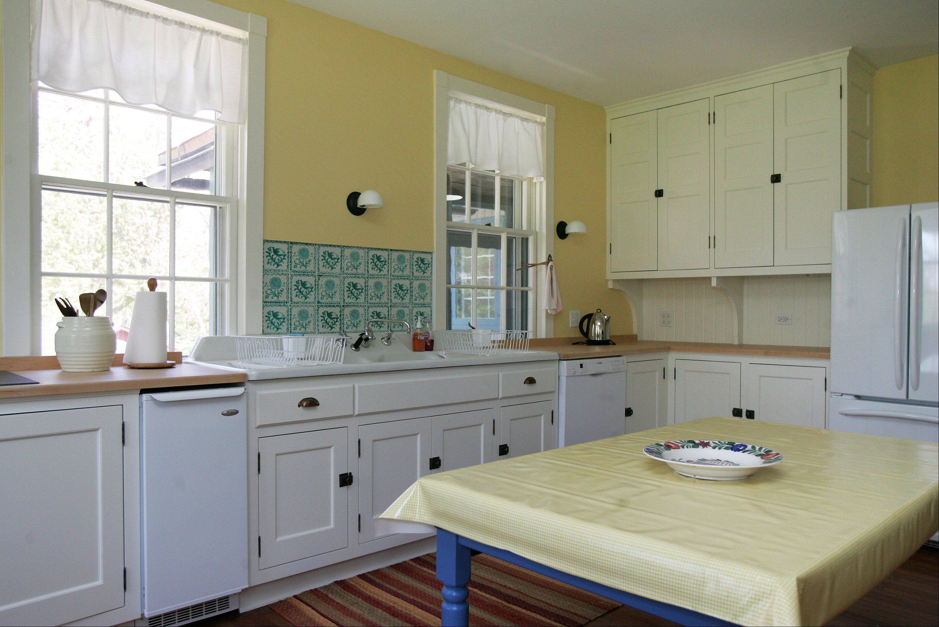 Residents love the cheery yellow of the Ragdale kitchen.