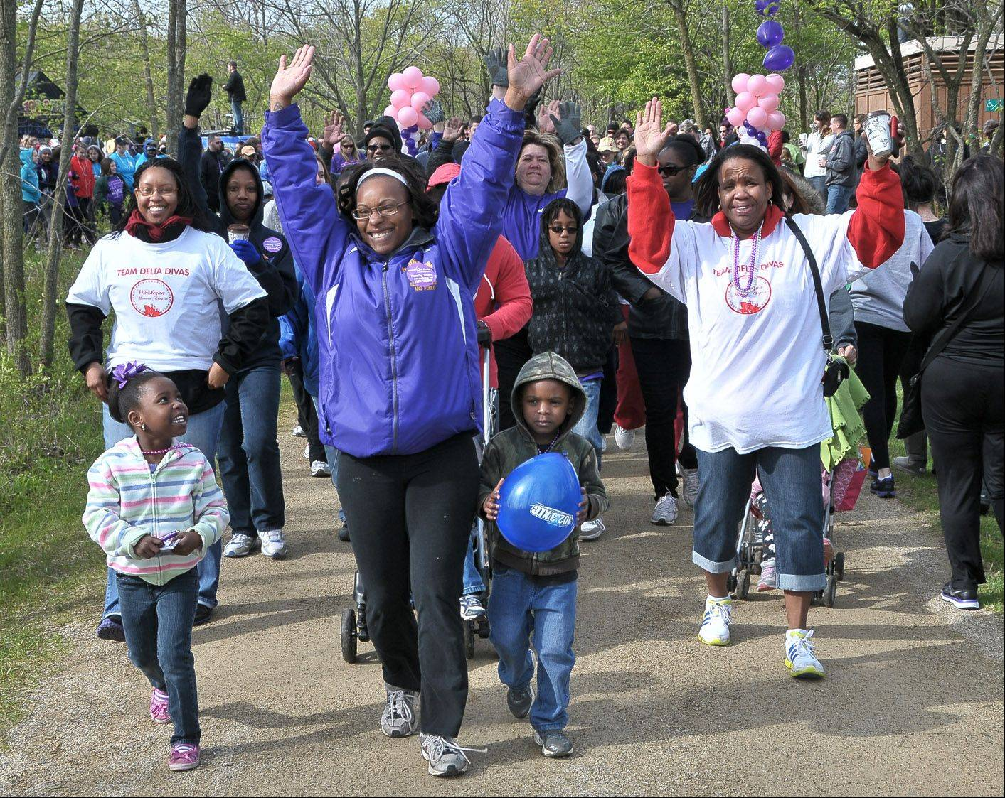 "The Davis family of Waukegan walks in the March of Dimes' ""March For Babies"" 5K walk Sunday in the Old School Forest Preserve in Libertyville."