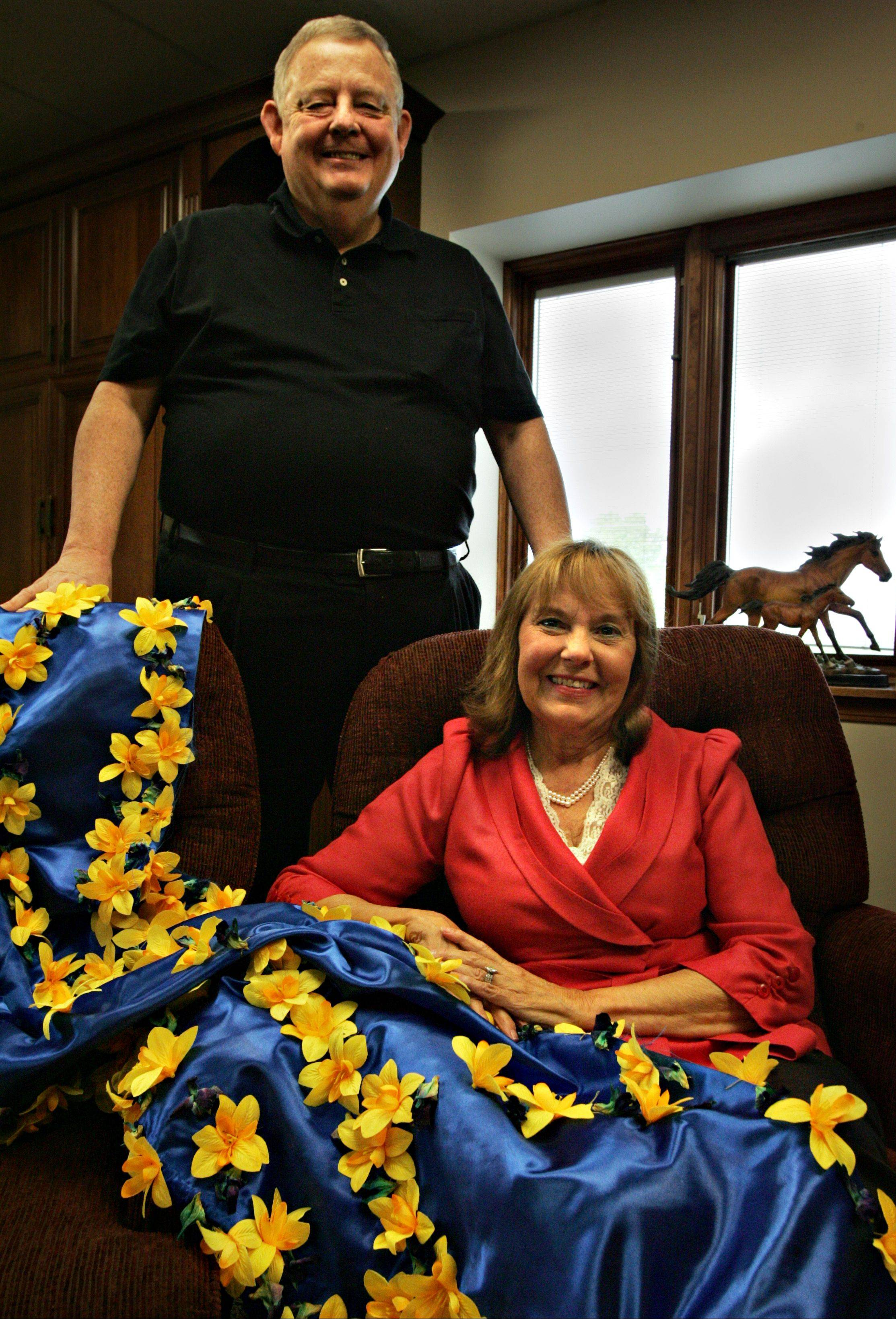 Chuck and Maribeth Sandford of Marengo are the owners of a horse named Take Charge Indy who is listed among the top contenders for the 2012 Kentucky Derby. The winner's garland on Maribeth's lap is the one that was presented to Take Charge Indy after he won the Florida Derby last month.