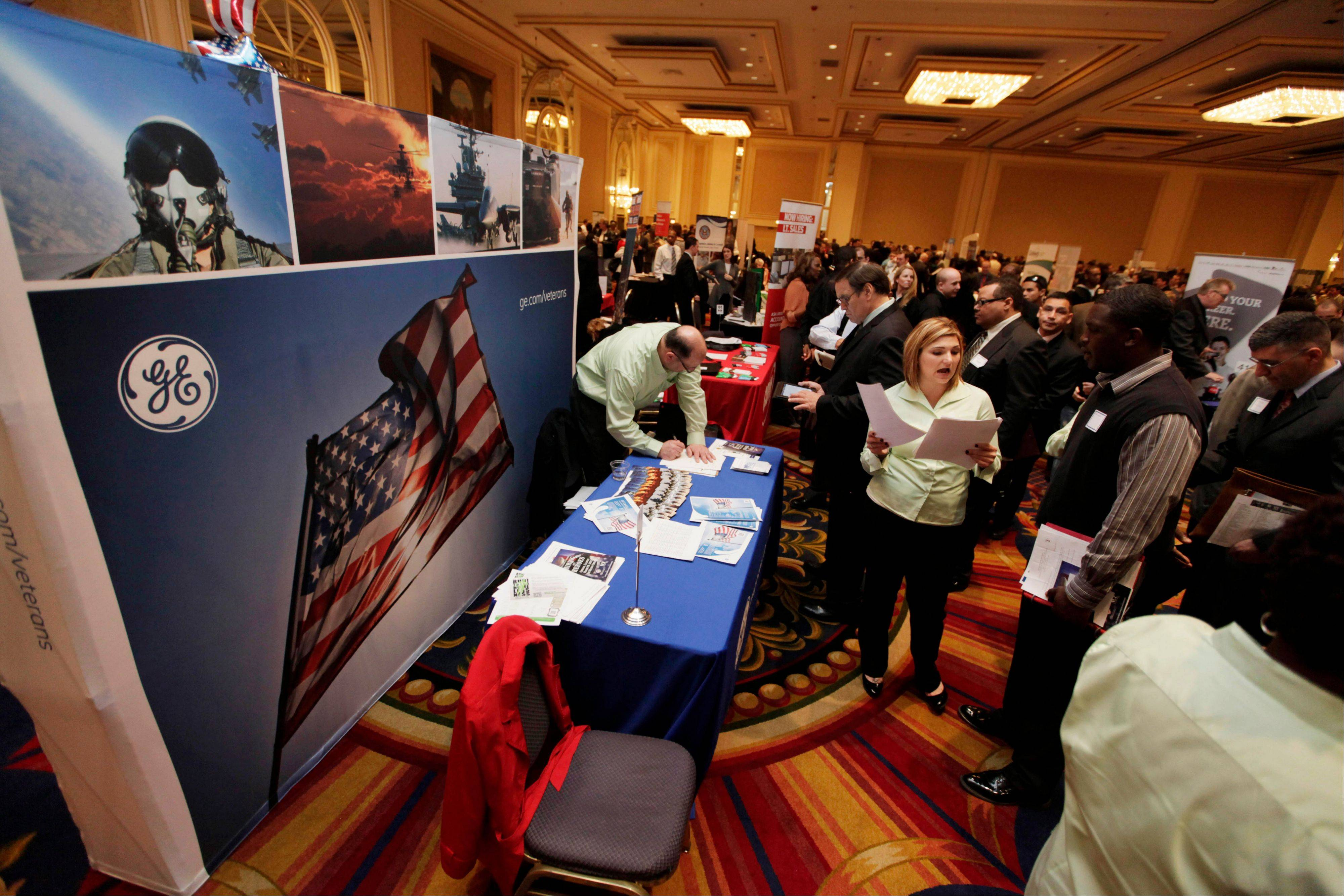 About 1,500 people and about 135 employers attended the Hiring Our Heroes job fair in Chicago, one of a series of events being sponsored by the U.S. Chamber of Commerce around the country.