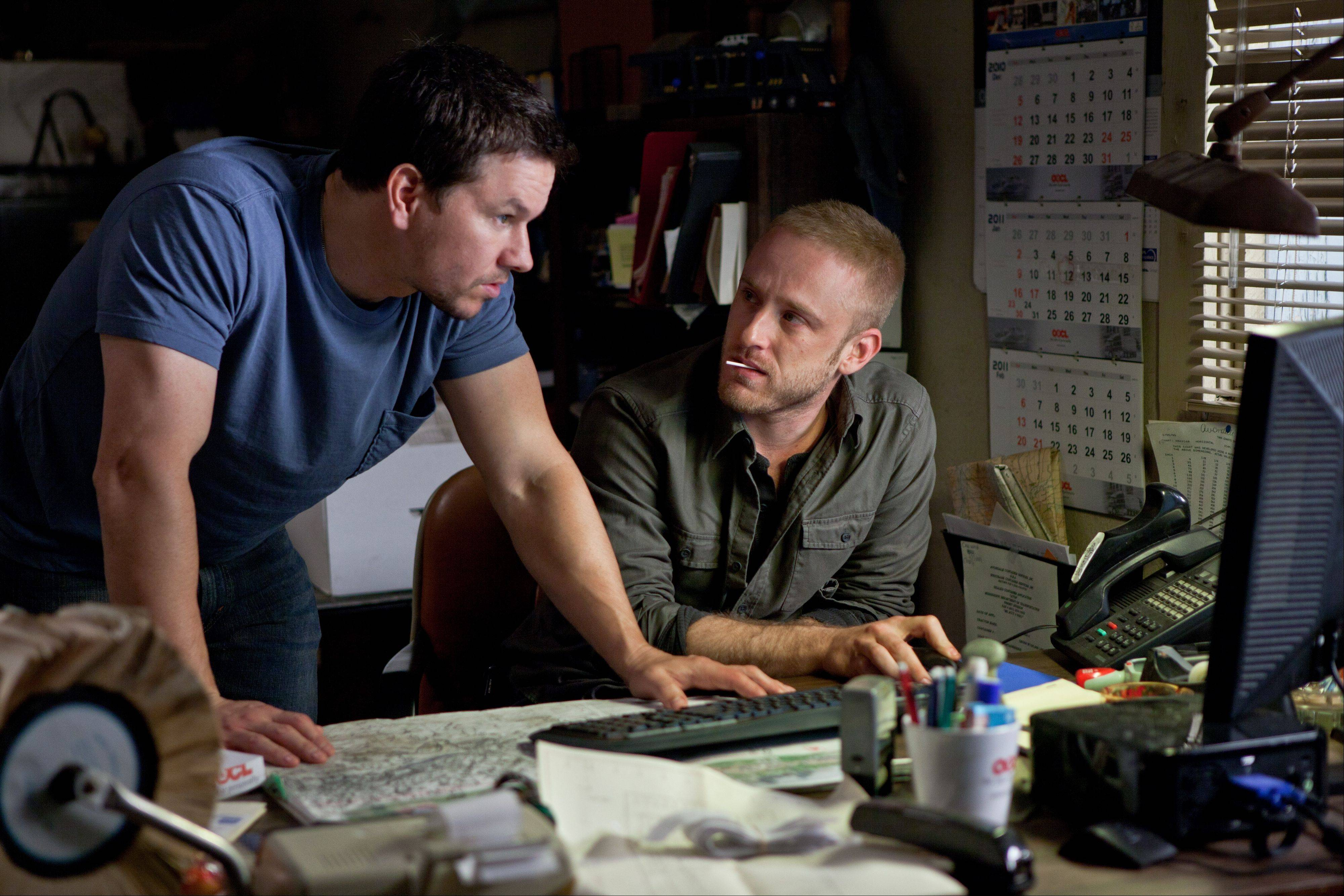 "Chris (Mark Wahlberg), left, discusses strategy with his pal Sebastian (Ben Foster) in the smuggling thriller ""Contraband."""