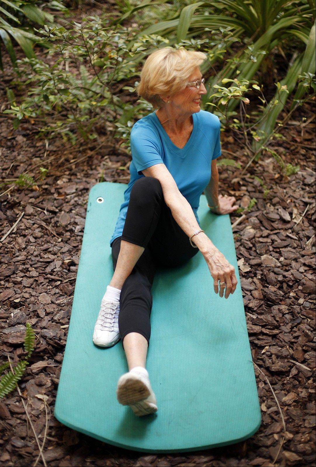 JoAnn French, 72, demonstrates a pretzel stretch.