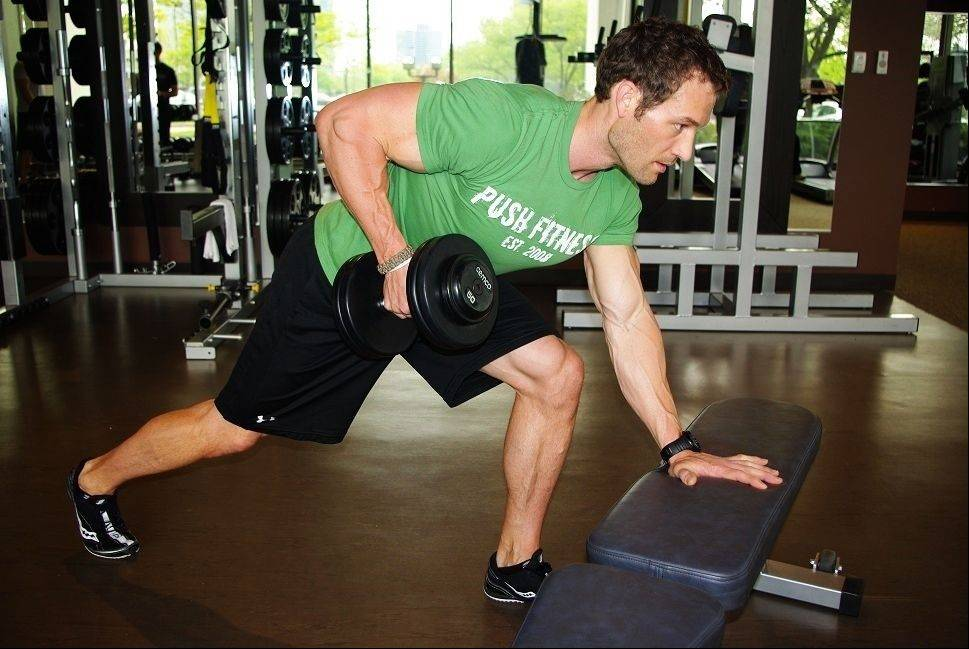 To execute the staggered one arm row: Pull the dumbbell upward and back in a rowing motion as you squeeze your right shoulder blade and mid back. Control the dumbbell back down until your arm is extended and repeat eight to 12 times.