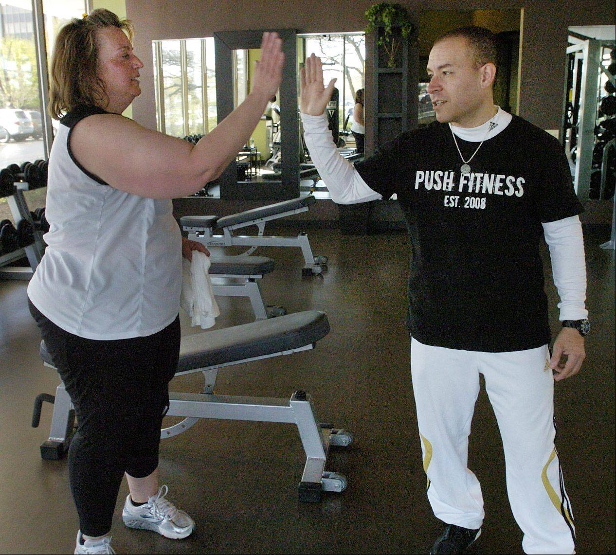 Karen Maranto fits right in at the gym thanks to the confidence instilled in her by trainer Tony Figueroa.